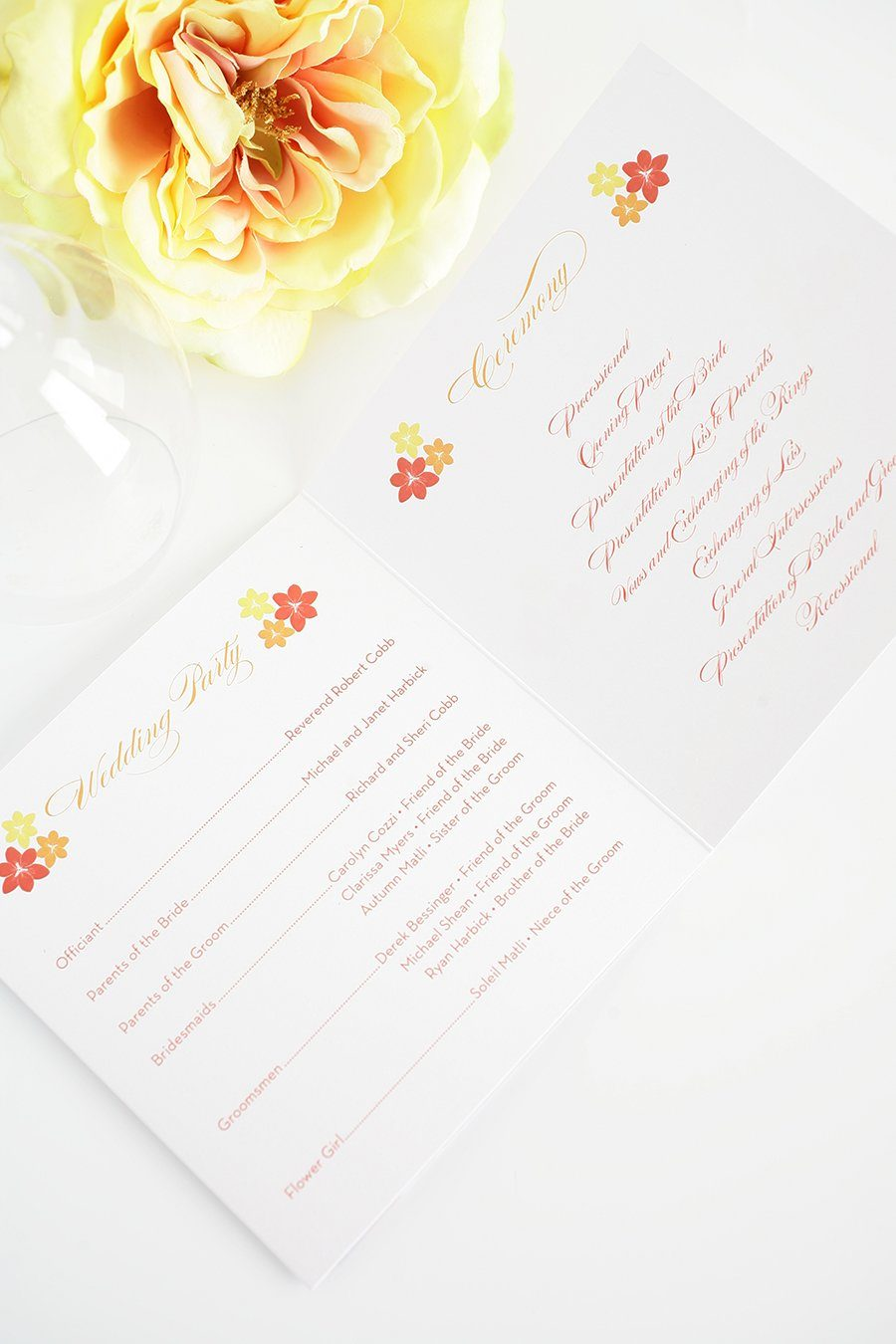 Red, yellow and orange wedding programs