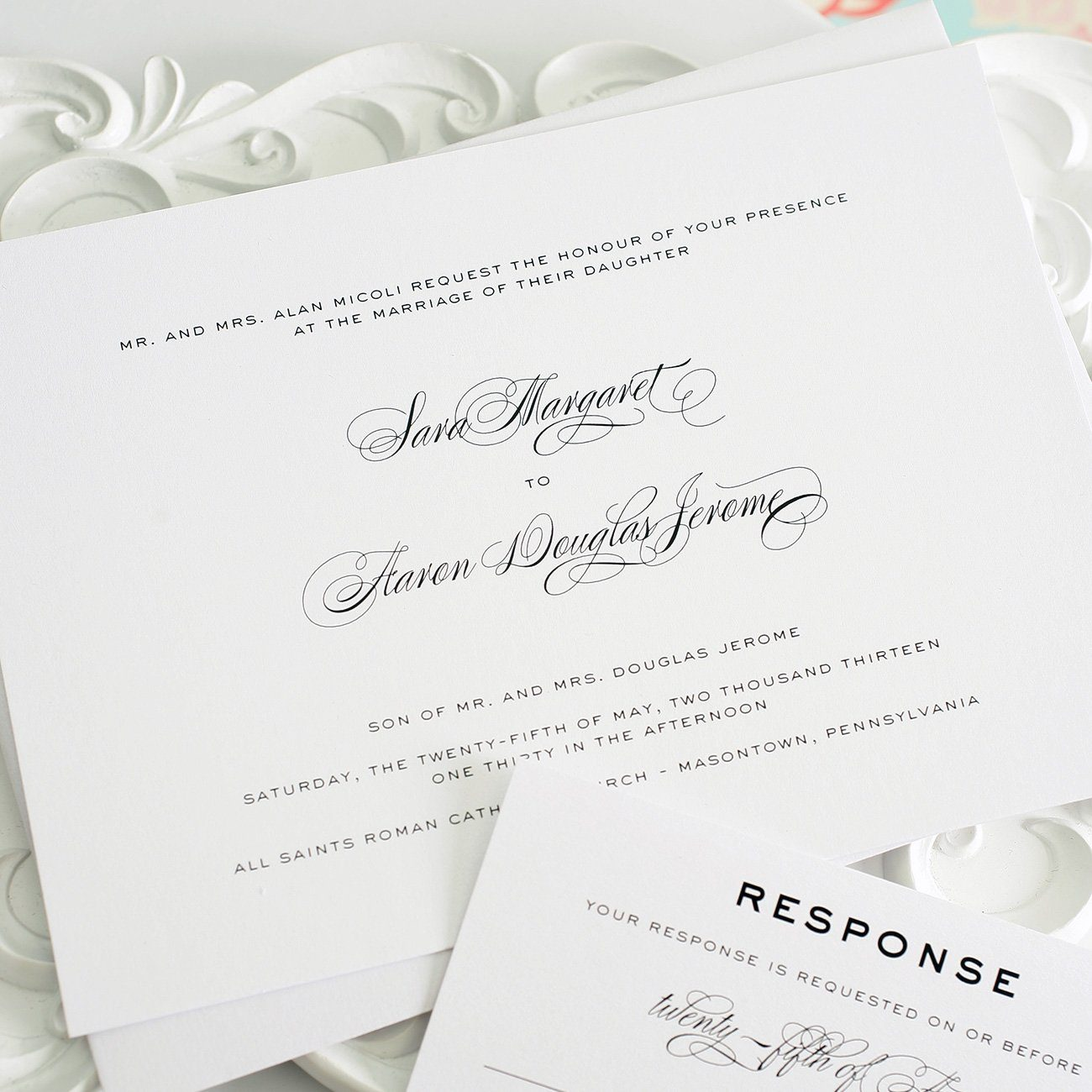 Traditional wedding invitations in white with script