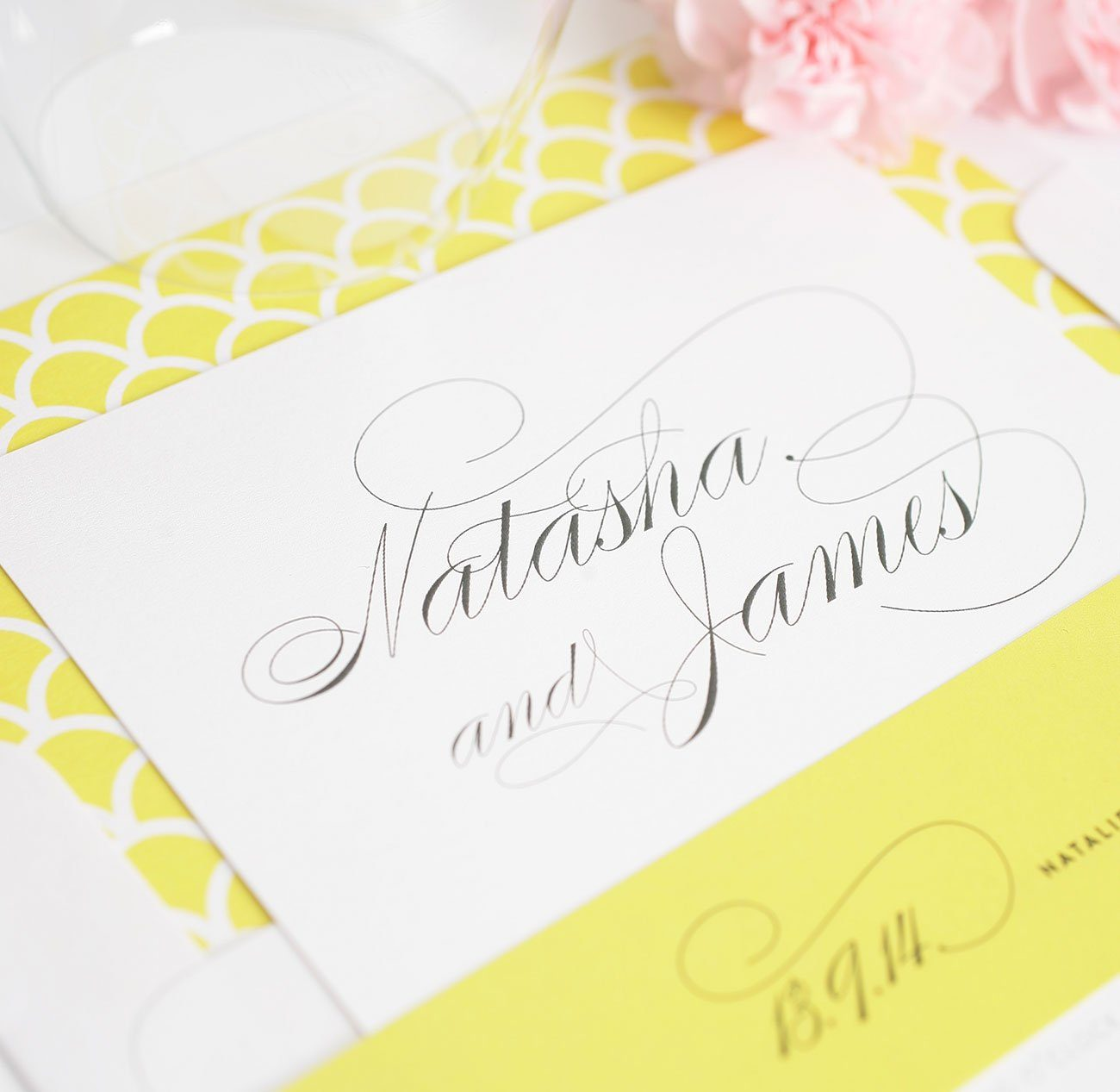 Yellow wedding invitations with script names