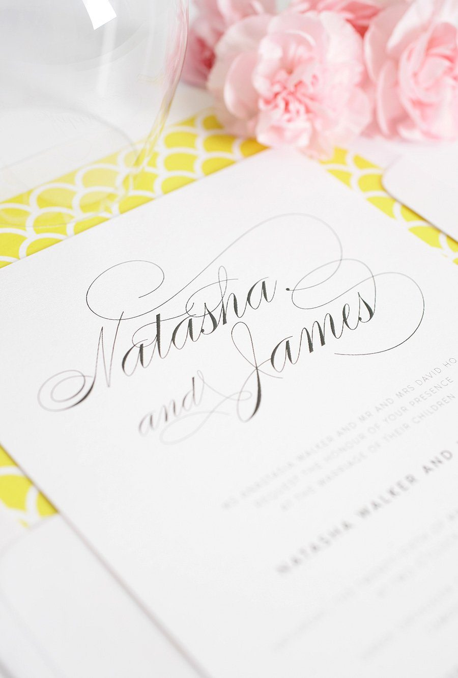 Elegant yellow wedding invitations with calligraphy