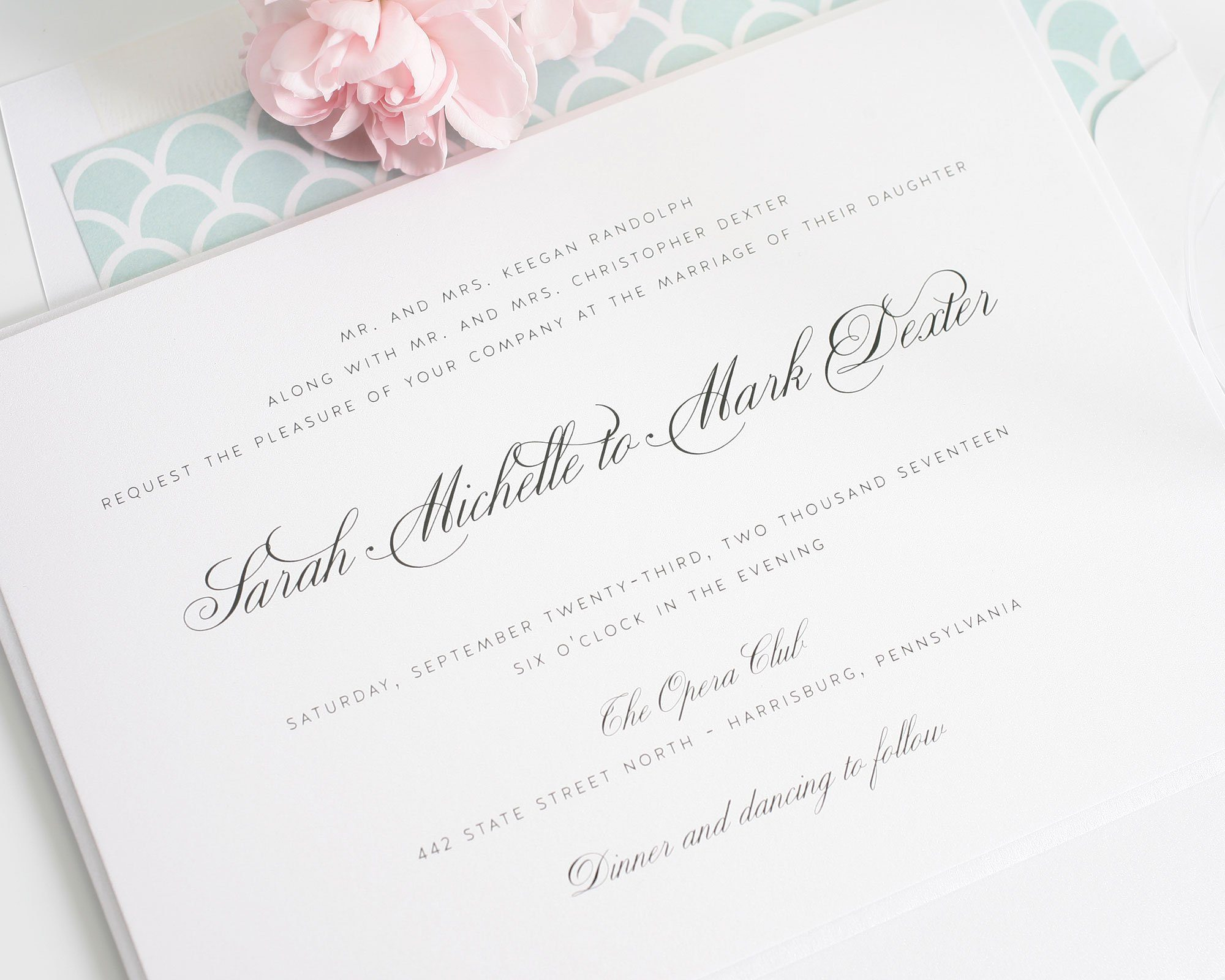 Elegant wedding invitations in mint