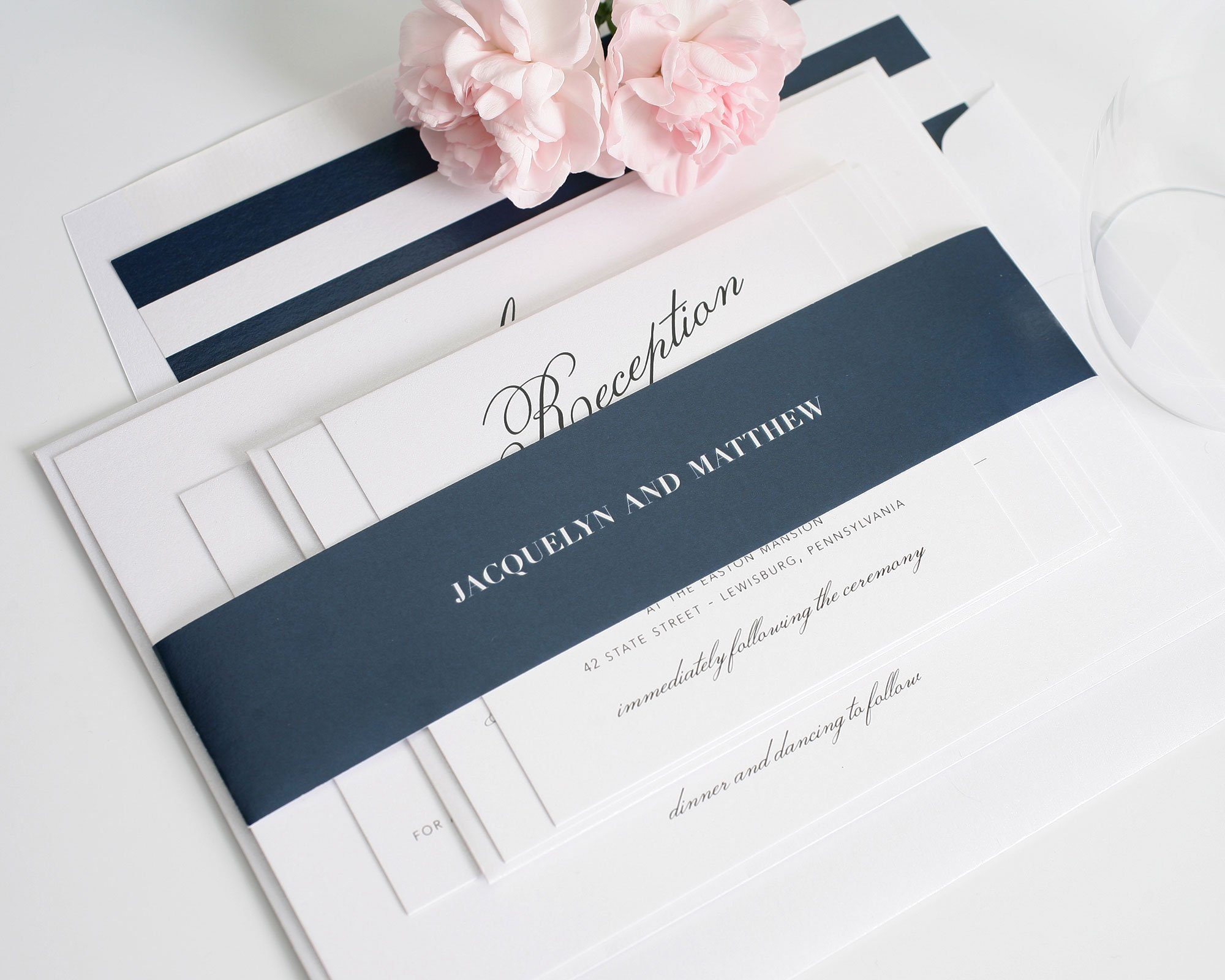 Navy blue wedding invitation with big names in script