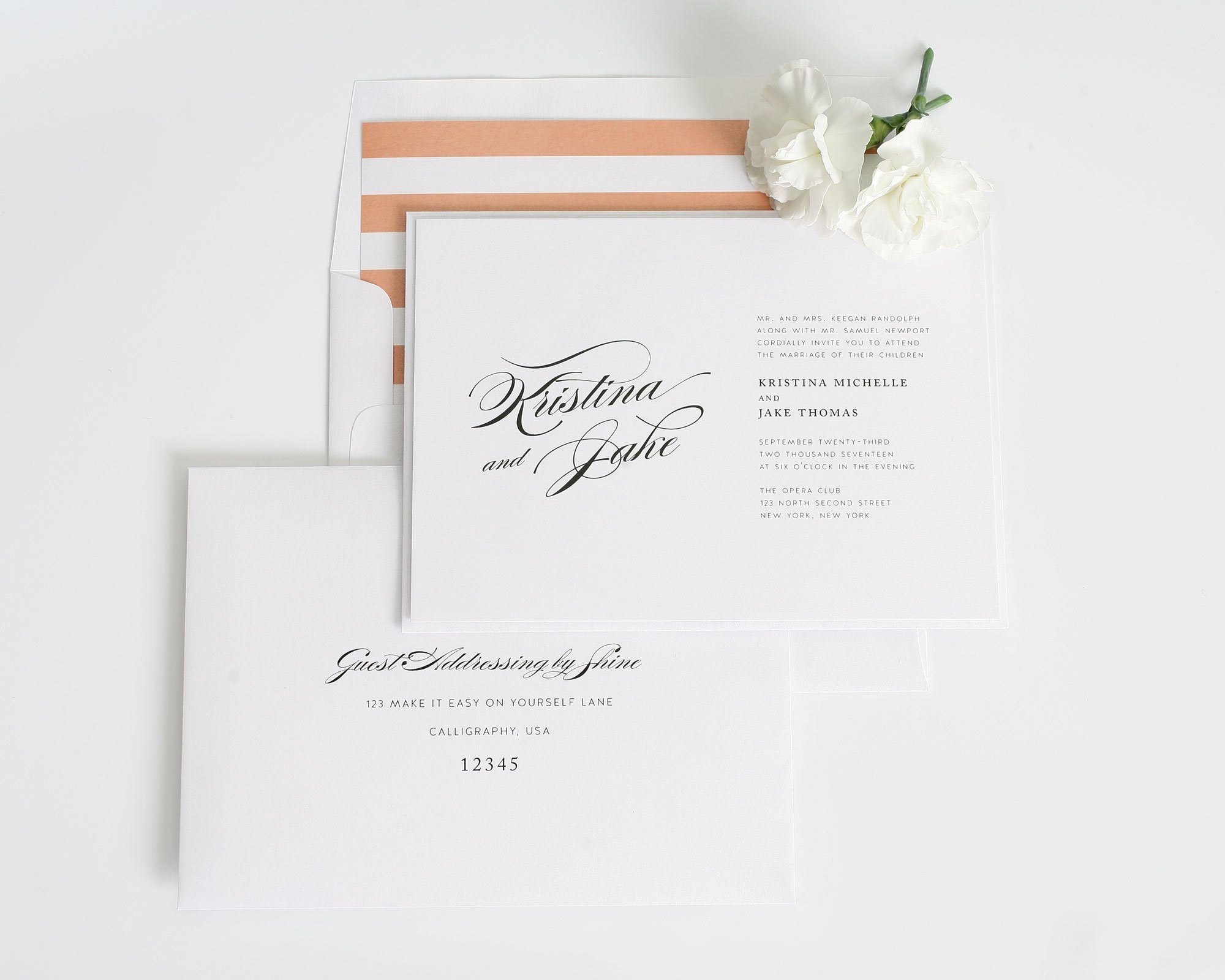 Romantic glamour wedding invites in peach