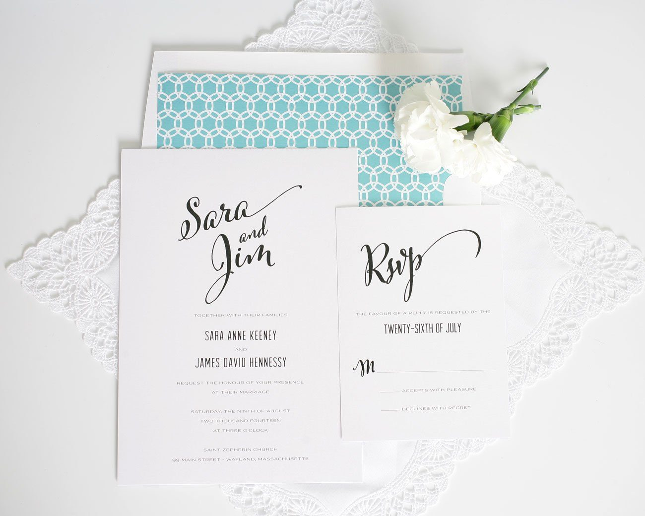 Gorgeous wedding invitations with large script and aqua accents