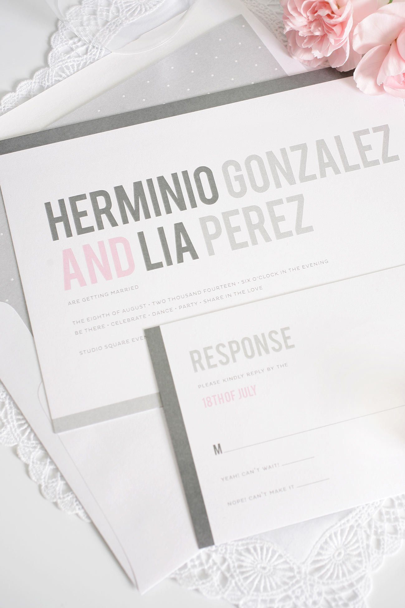 Modern pink and grey wedding invites with polka dot liner