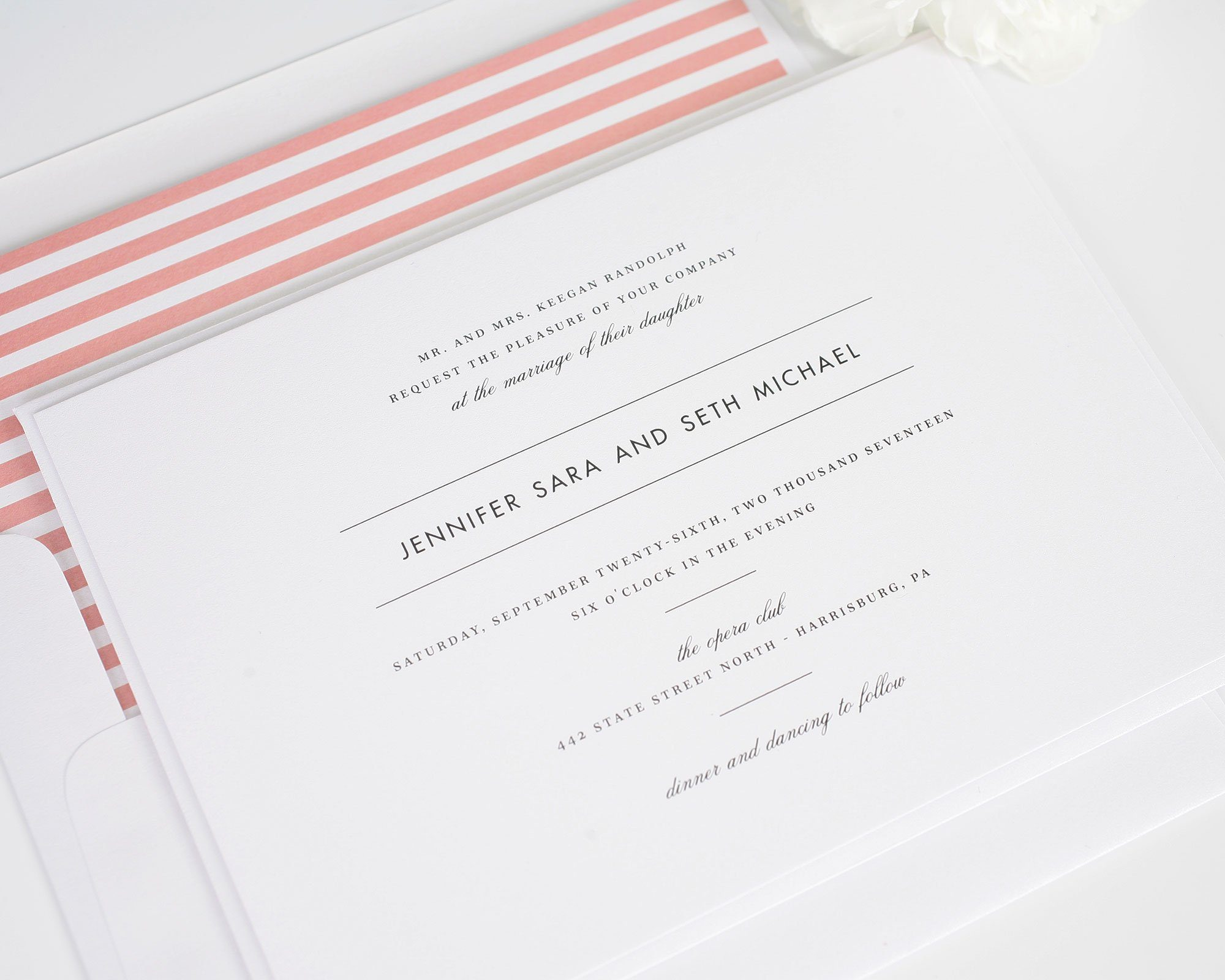 modern wedding invitation with coral accents