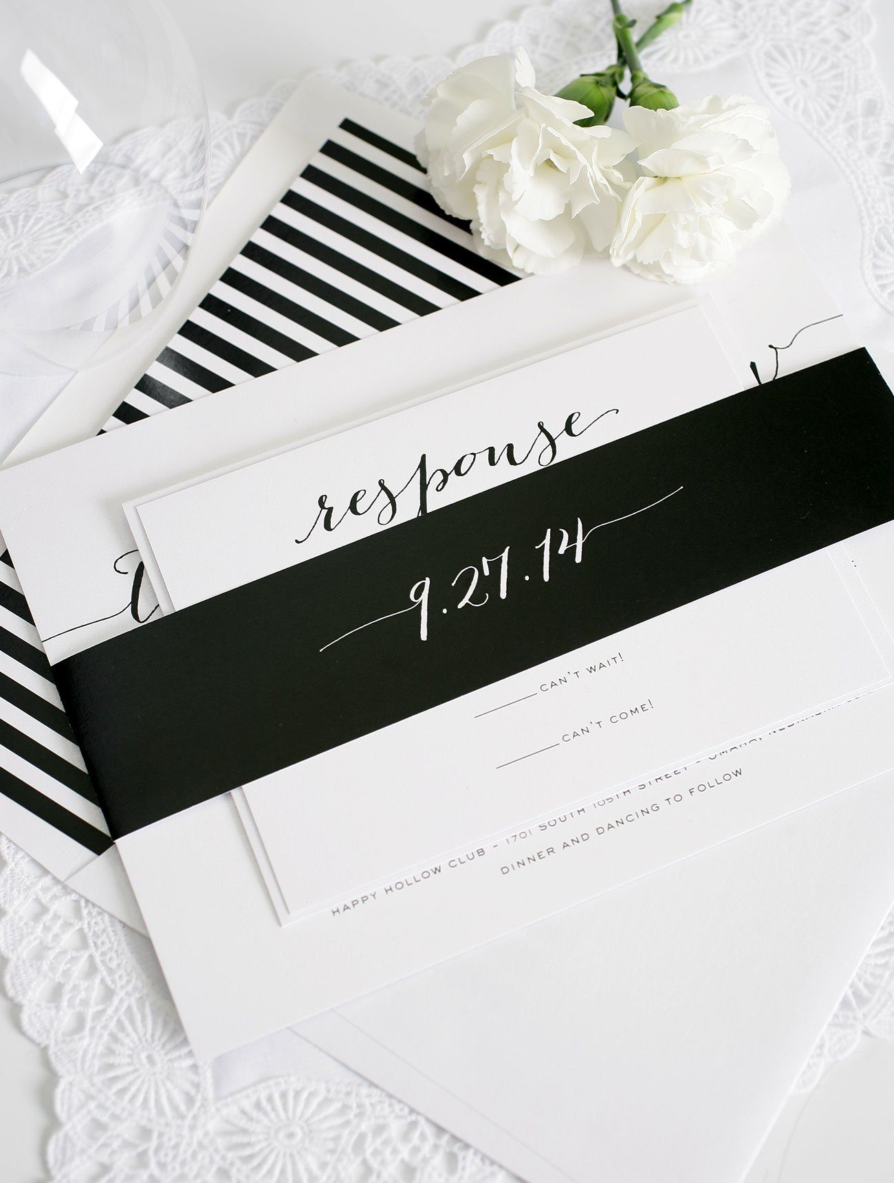 Black and white wedding invitations with flowing script