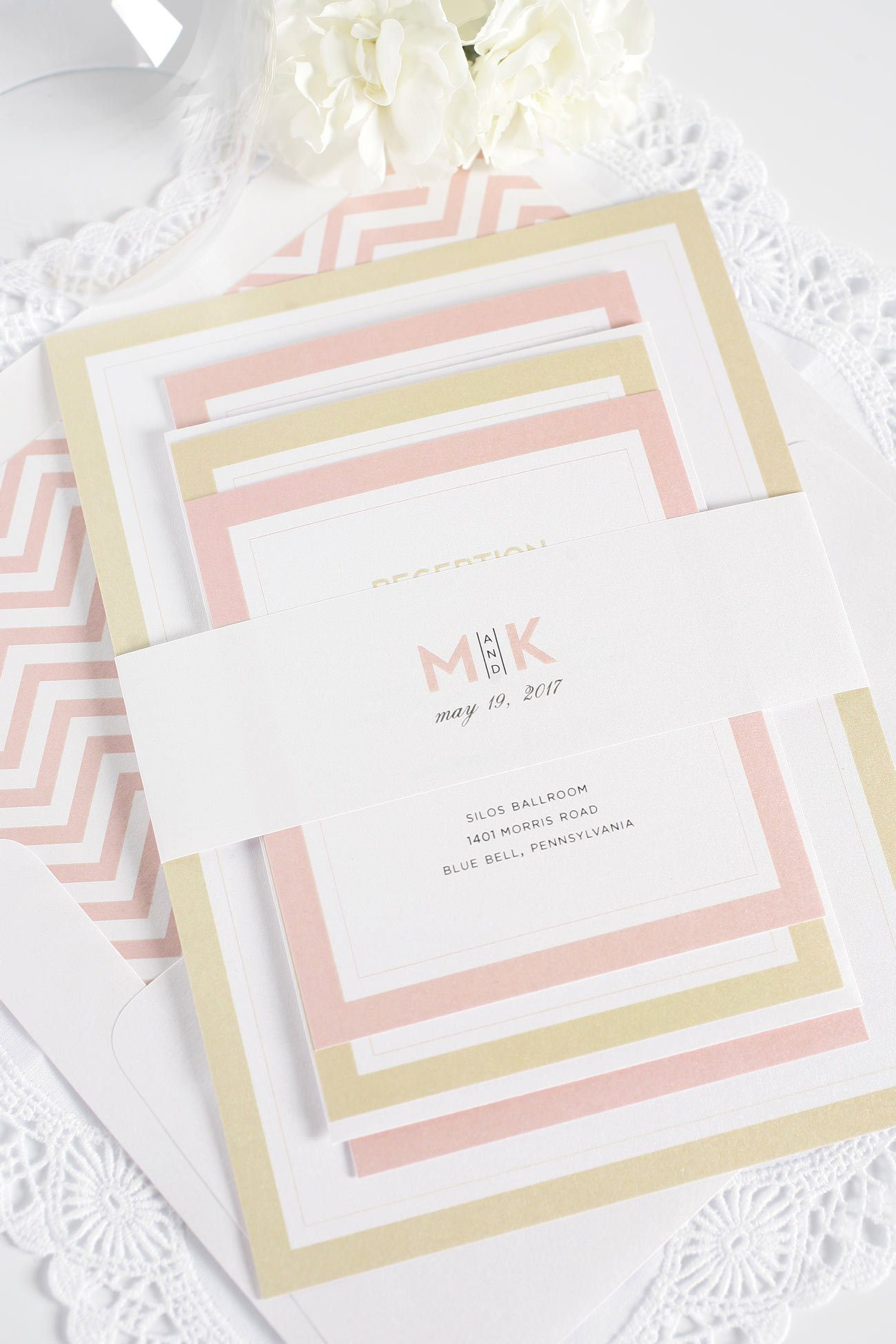 Modern blush and gold wedding invitations with chevron