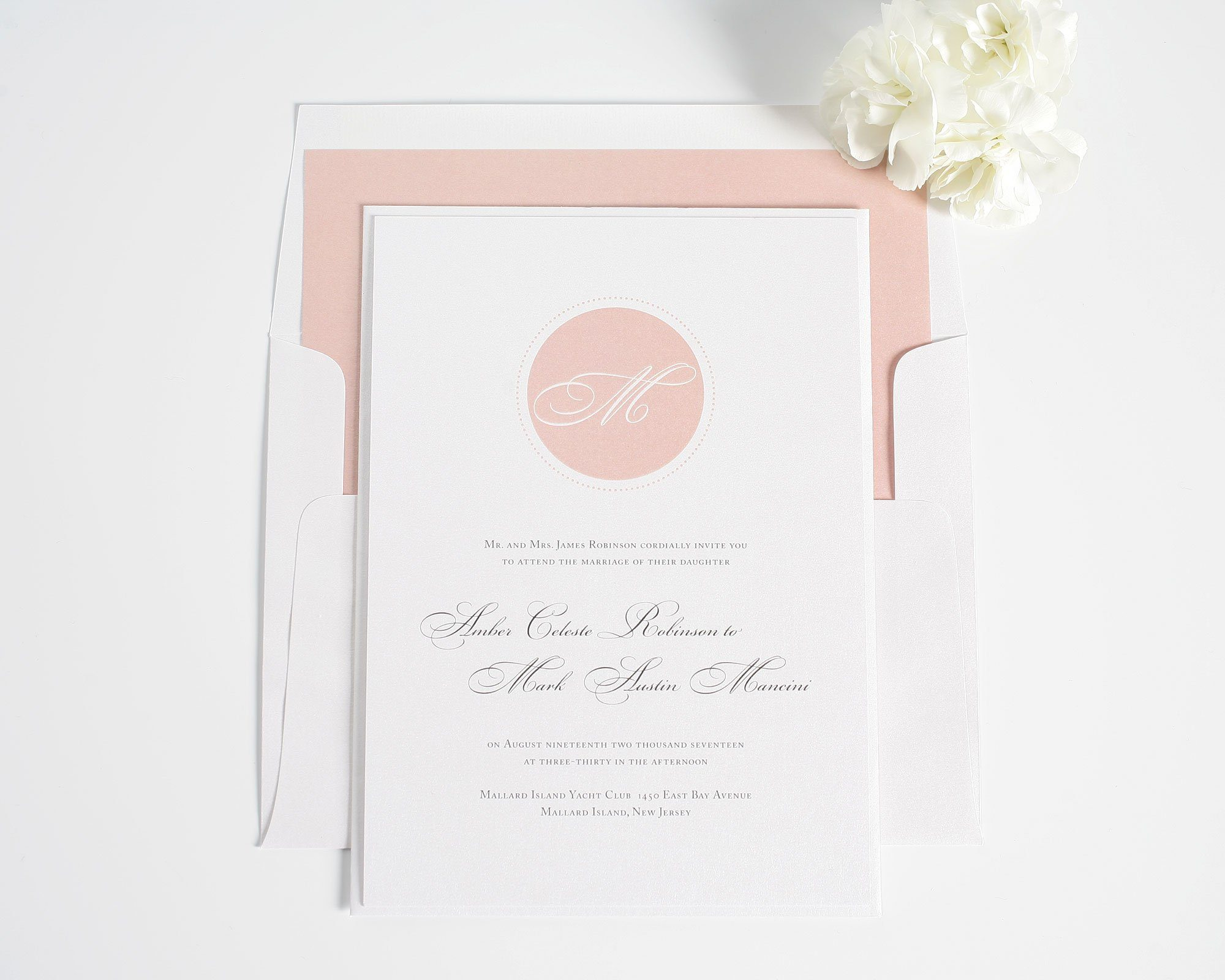 Blush pink wedding invitation with monogram