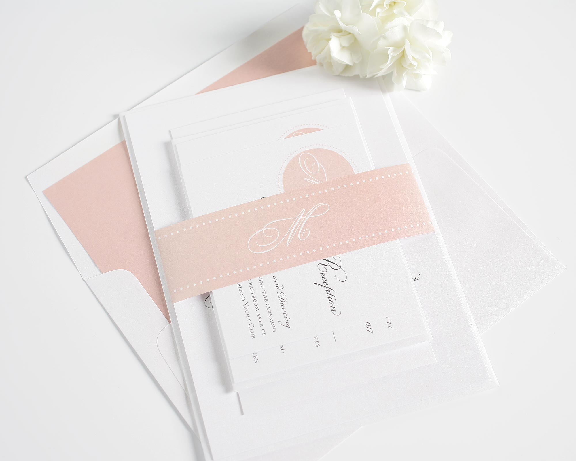 Blush wedding invitations with monogram