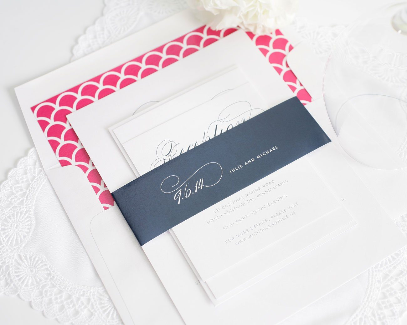 Elegant navy wedding invitations with pink accents