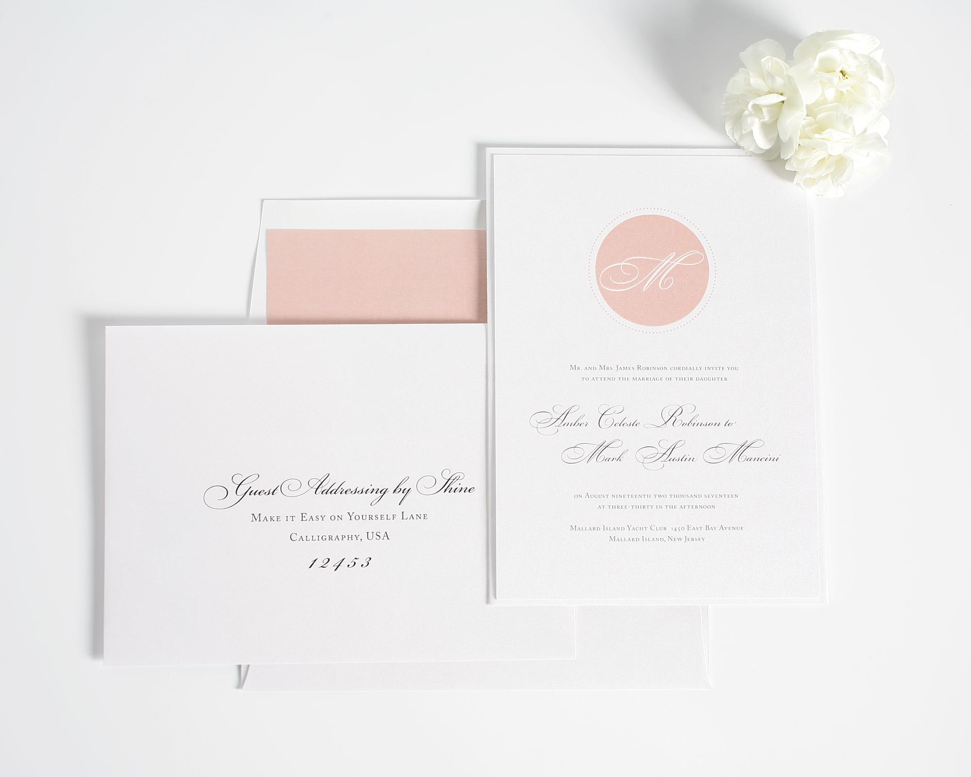 Blush wedding invitations with circle monogram