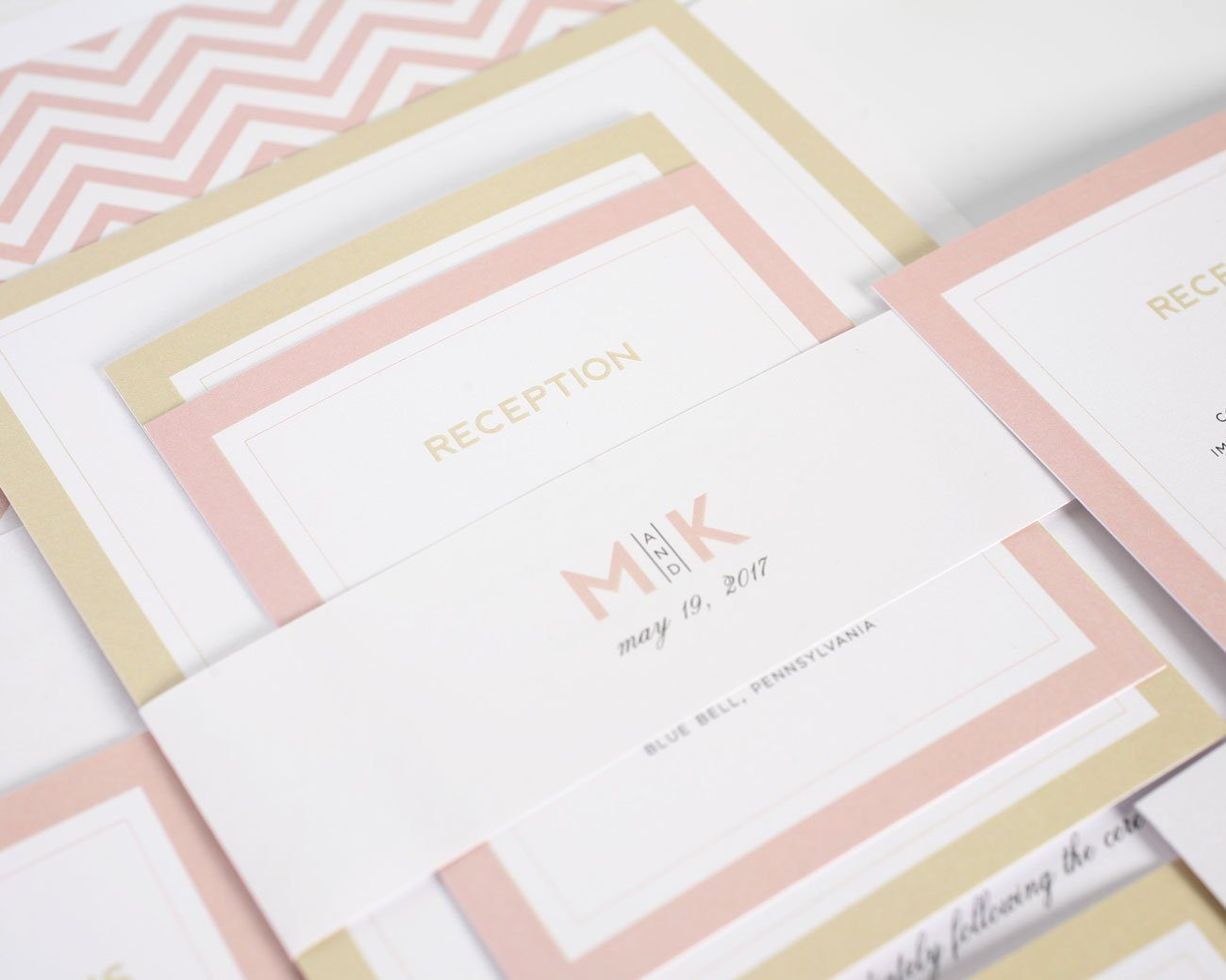 Modern wedding invitations in blush and gold