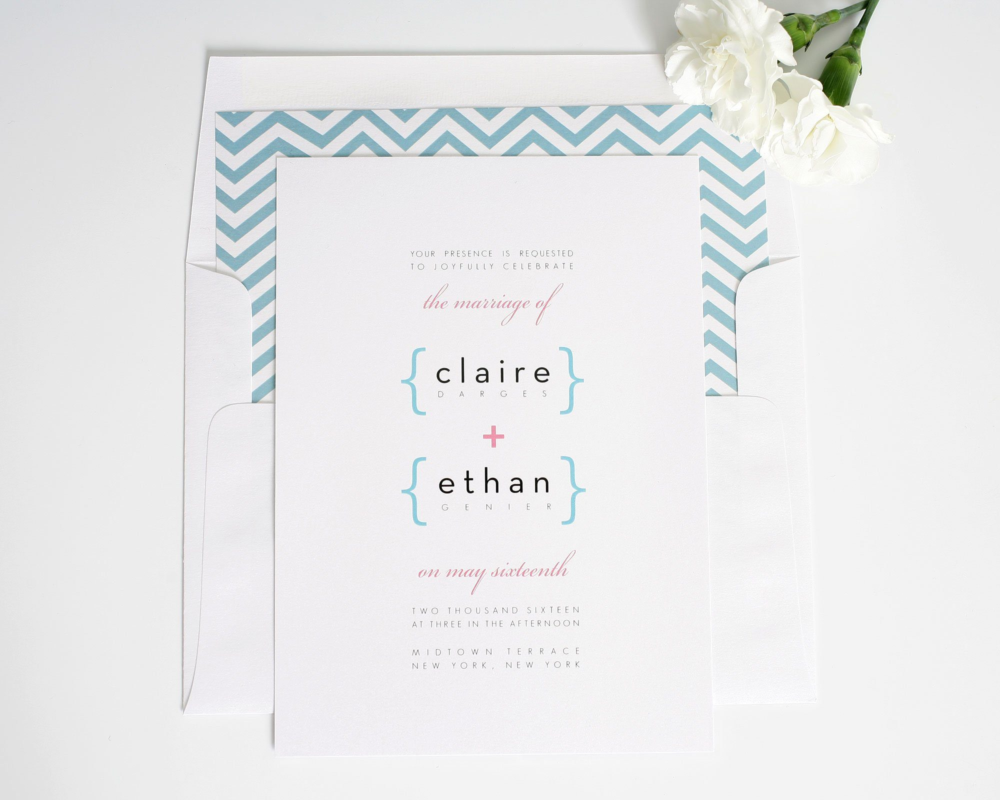 Modern wedding invitations in blue and pink