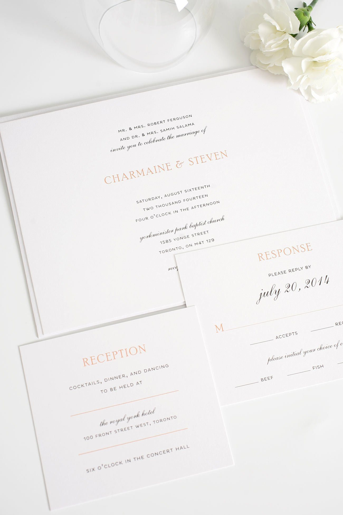 Elegant wedding invitations with peach accents