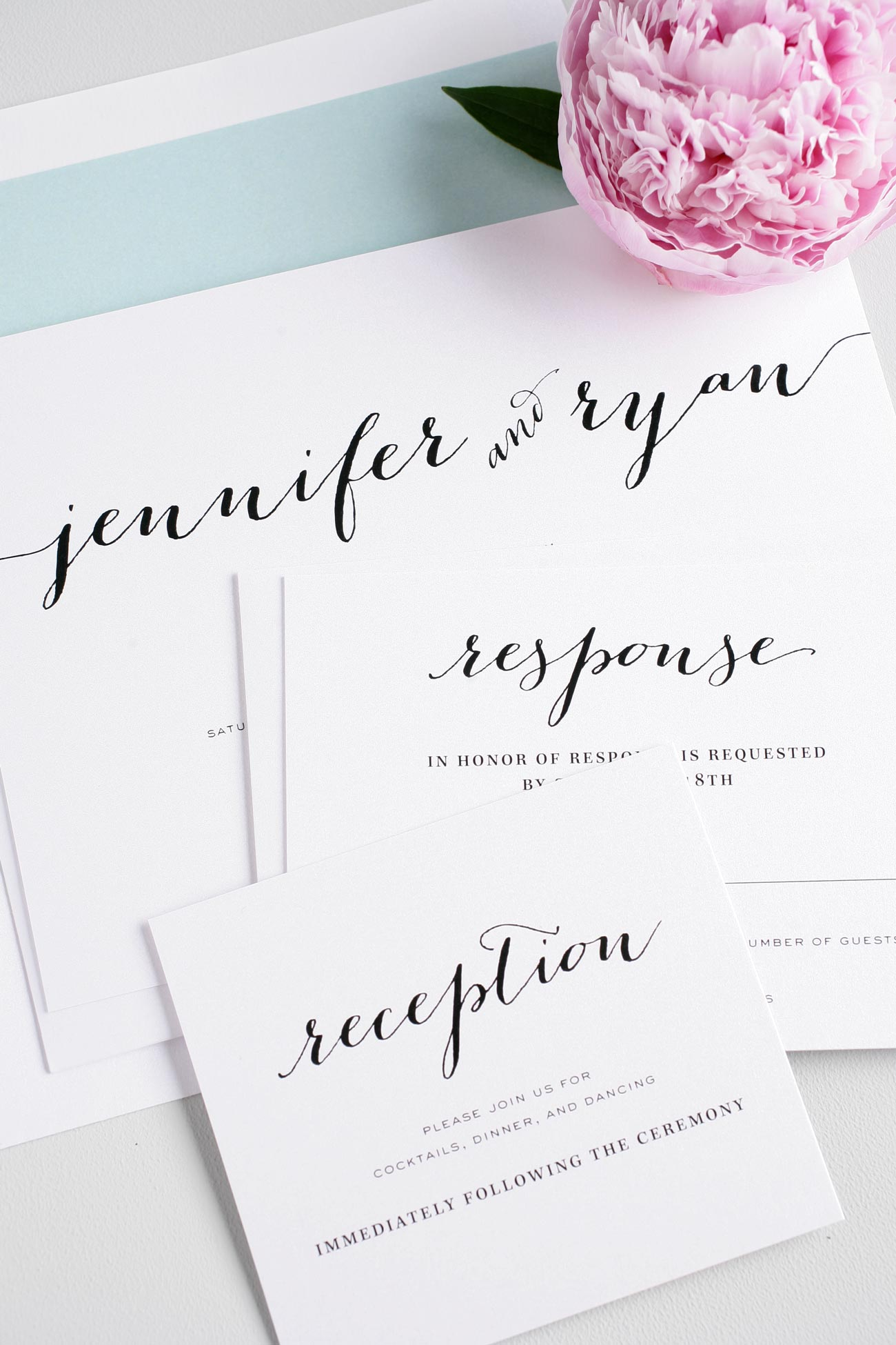 Calligraphy wedding invitations with mint accents