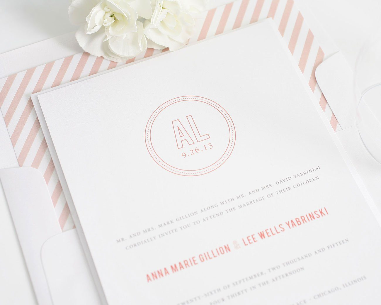 coral wedding invitations with a circle monogram