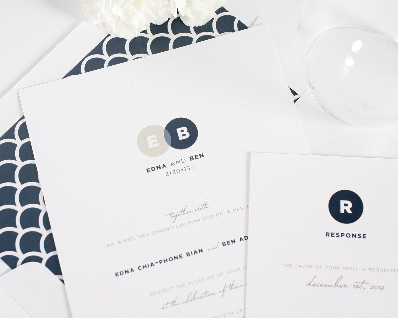 Neutral wedding invitations with navy scalloped liner