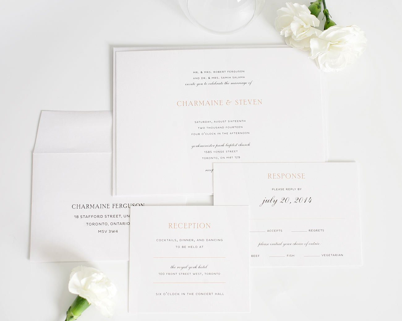 Simple and elegant wedding invitations with peach accents
