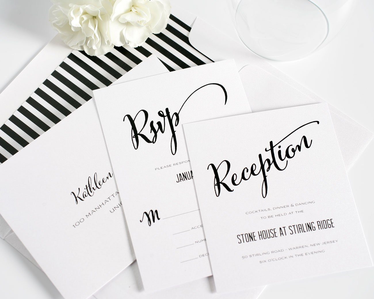 Mod black and white wedding invitations with striped envelope liner