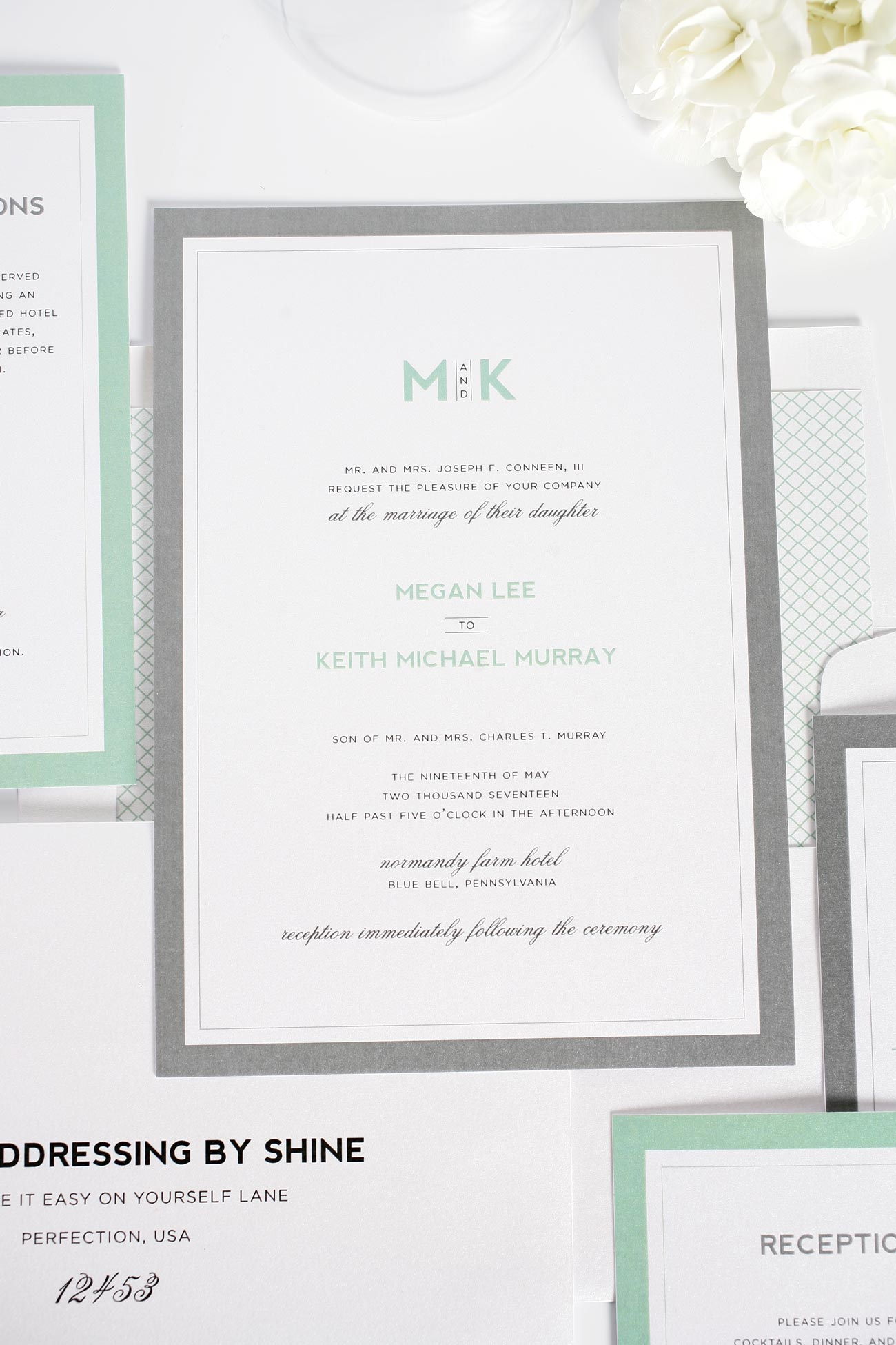 Modern wedding invitations in gray and mint with monogram