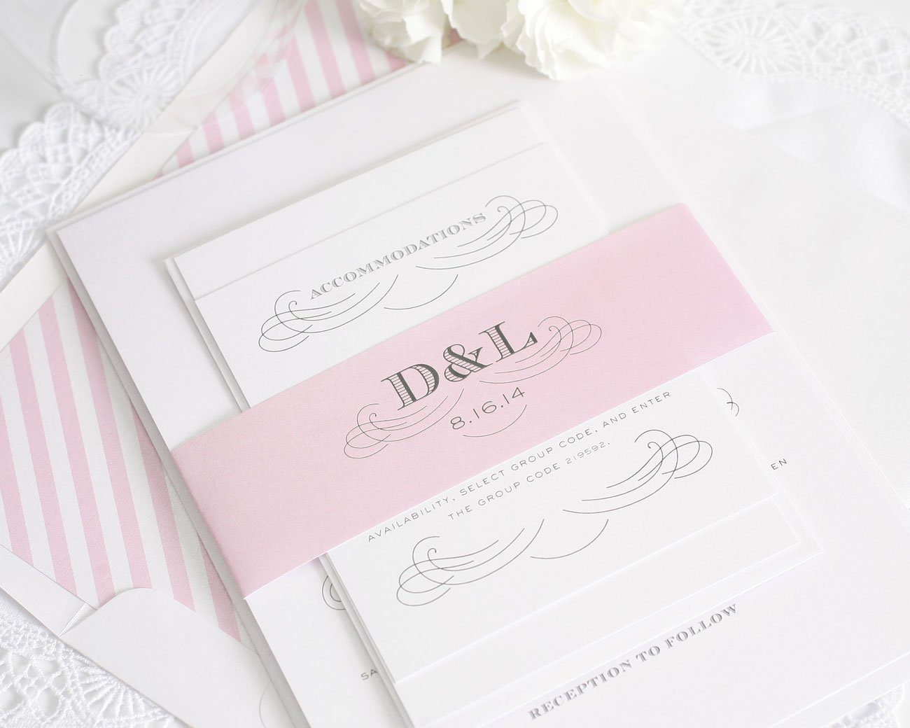 Monogram wedding invitations in blossom pink