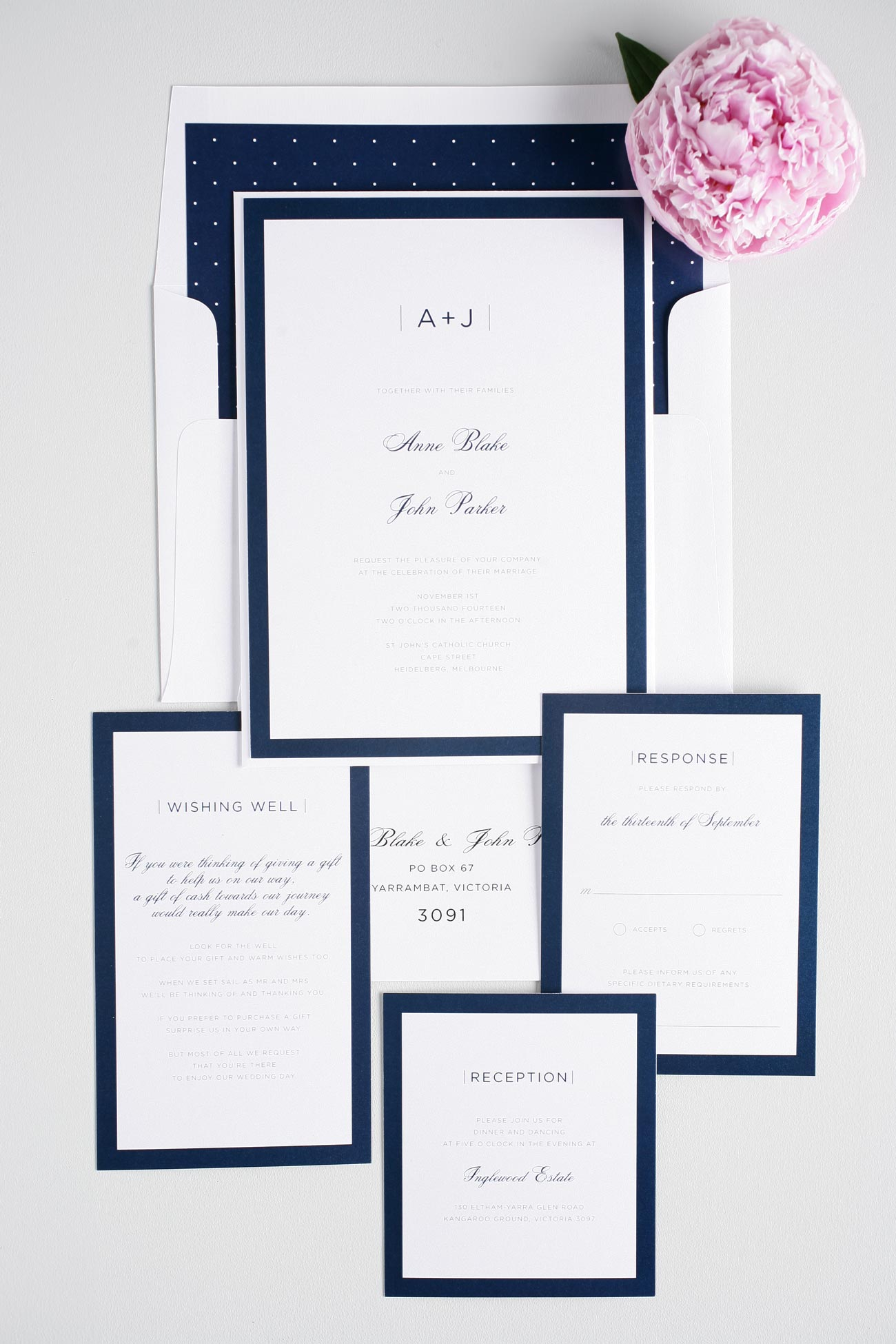 Navy blue wedding invitations with polka dot accents