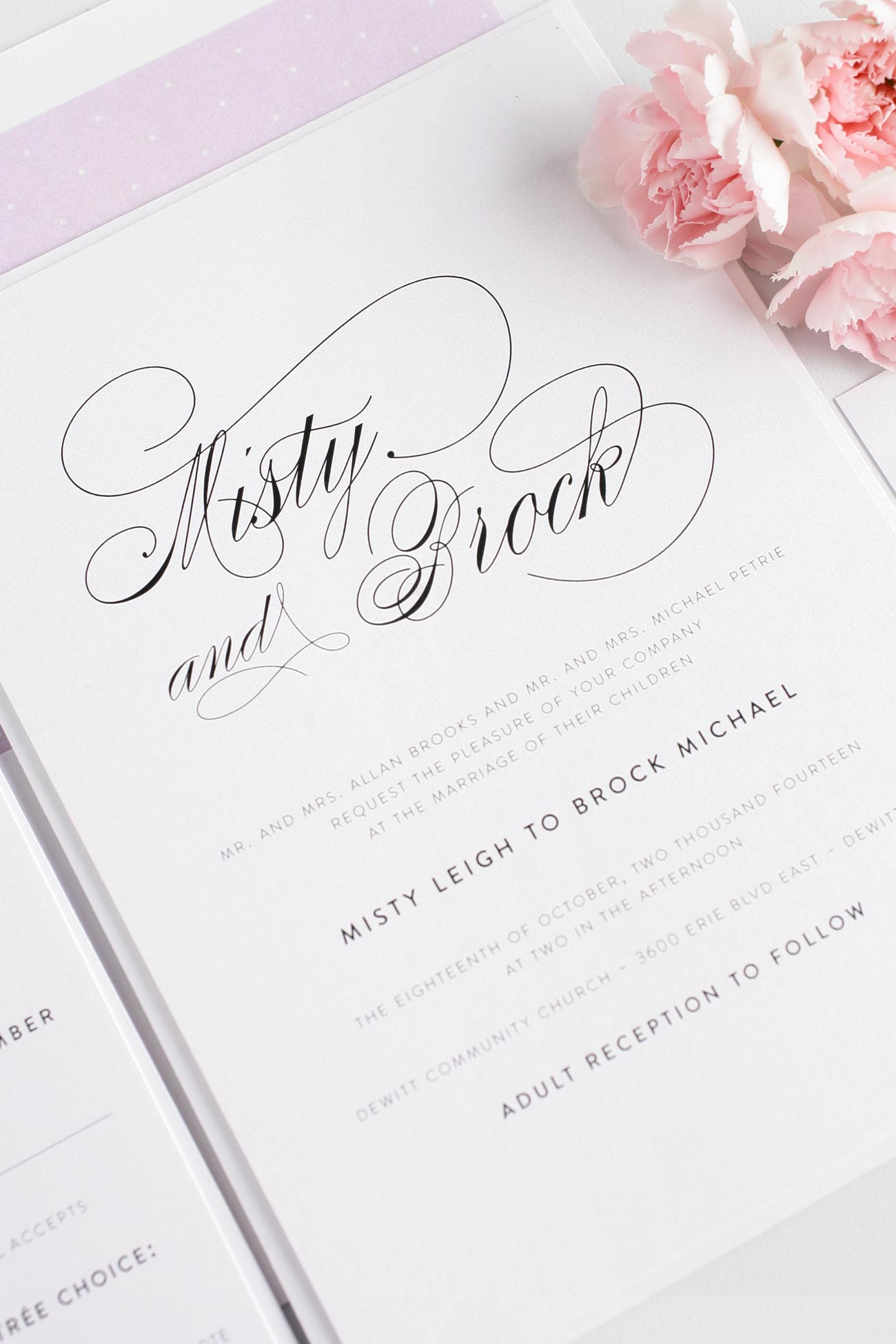 Elegant script wedding invitations in purple
