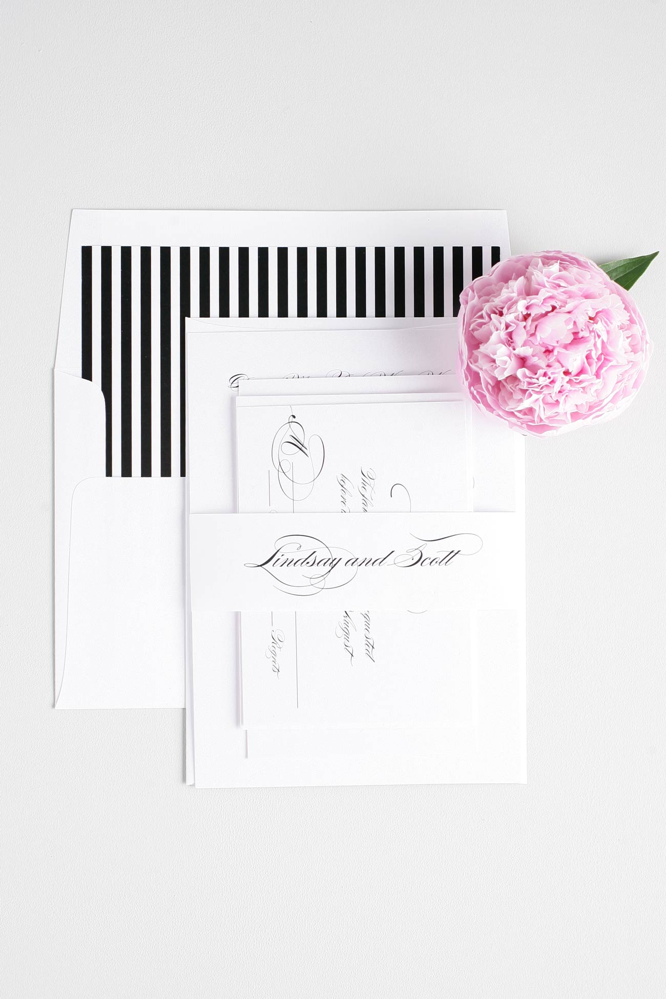 Gorgeous script wedding invitations with striped envelope liner