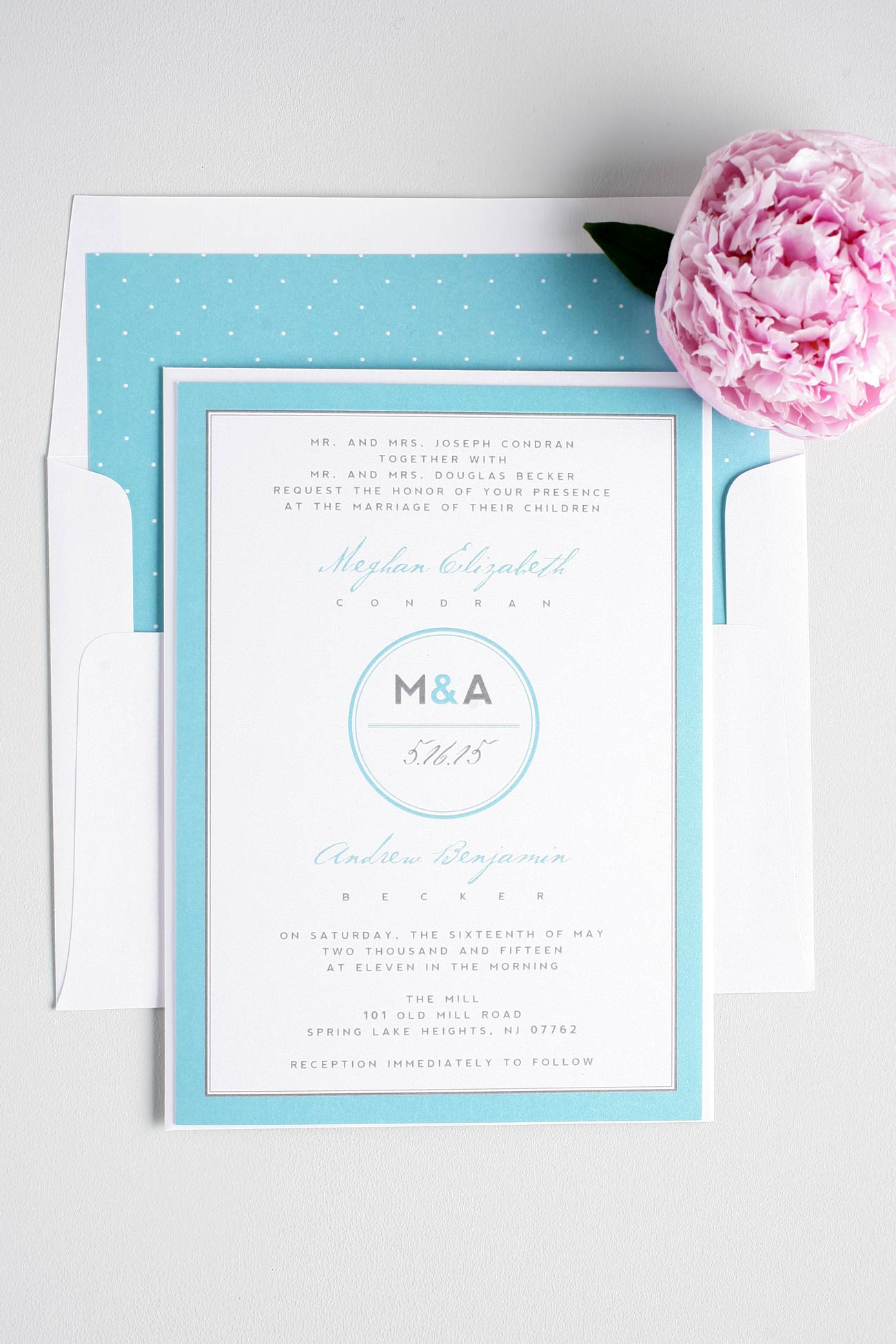 Modern monogram wedding invitations in blue with polka dots