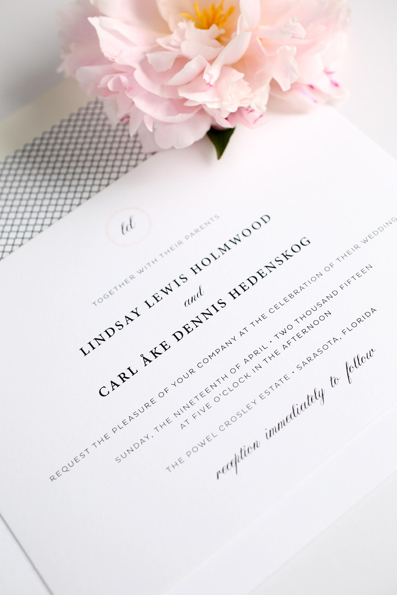 Vintage blush wedding invitations with script monogram and crosshatch details