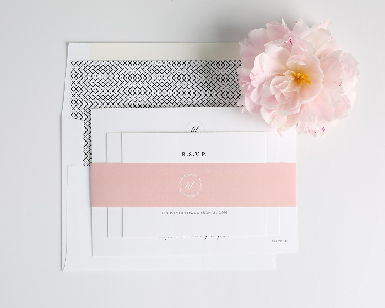 Vintage blush wedding invitations with a crosshatch envelope liner