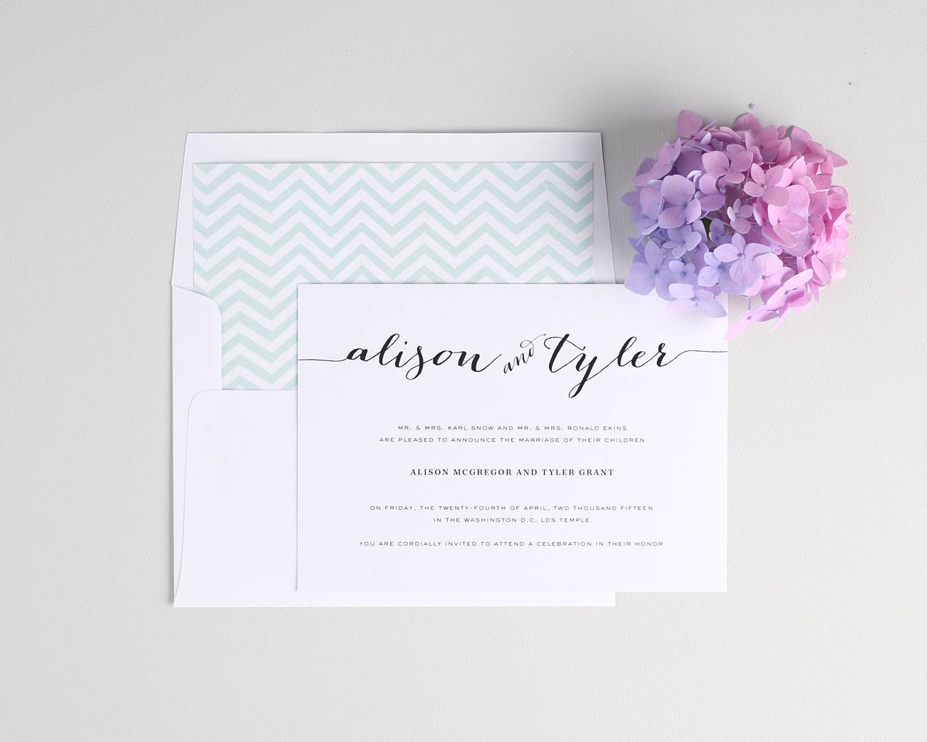Flowing Script Wedding Invitations with jade chevron accents