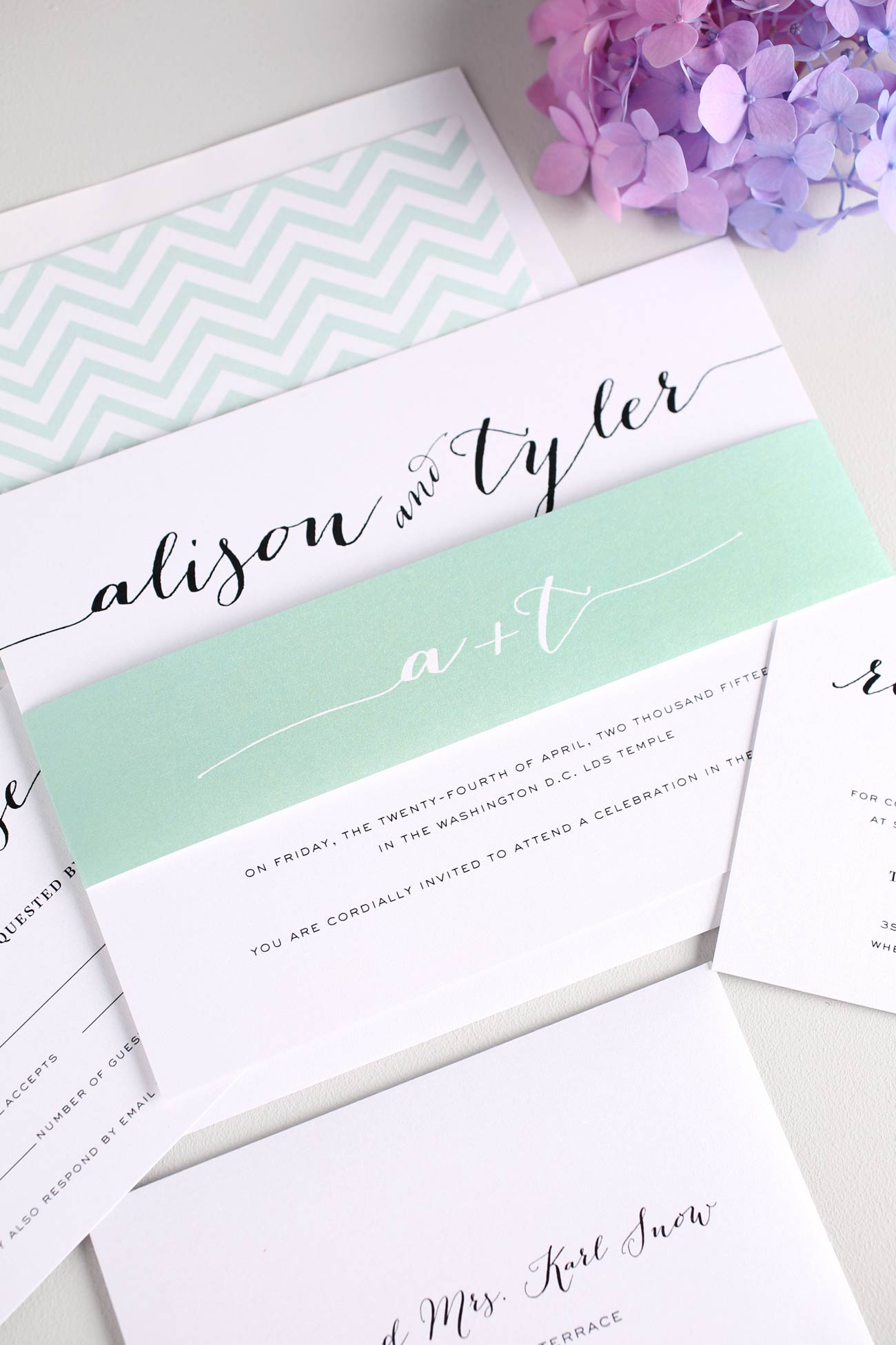 Jade wedding invitations with chevron accents and pretty script