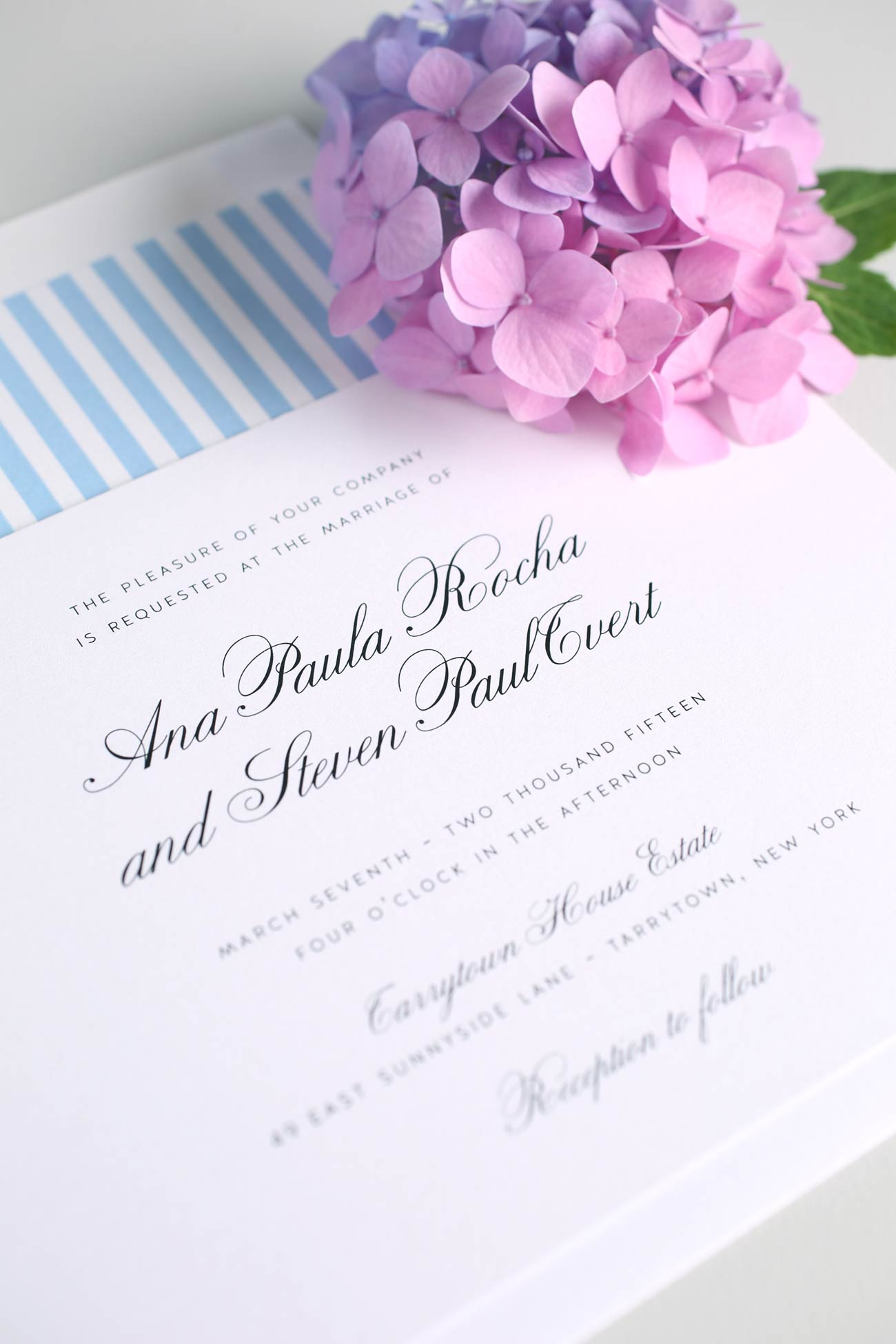 Light blue wedding invitations with a striped envelope liner