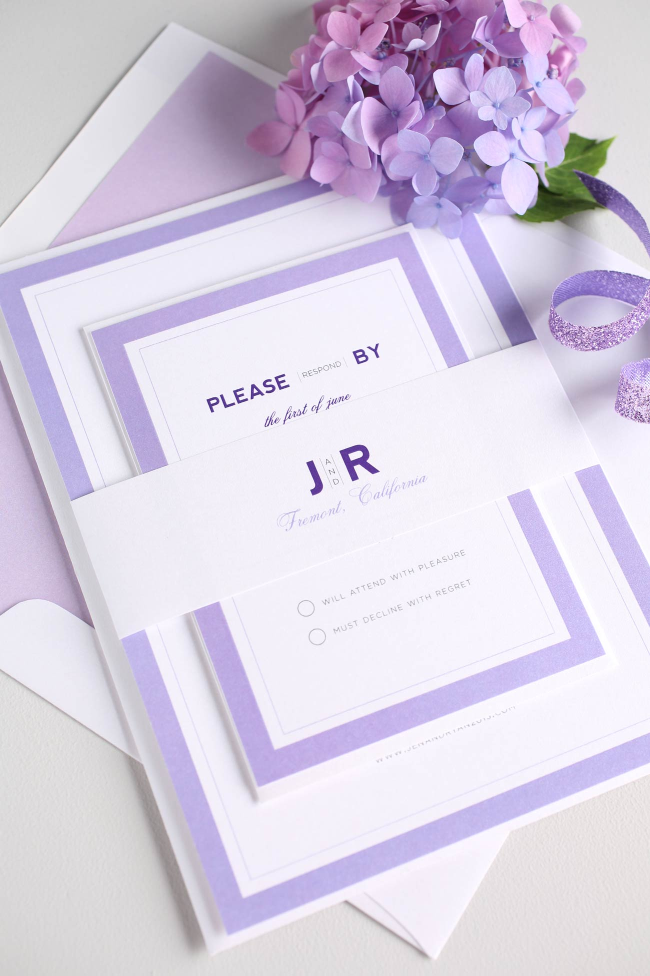 Monogram wedding invitations in purple ombre