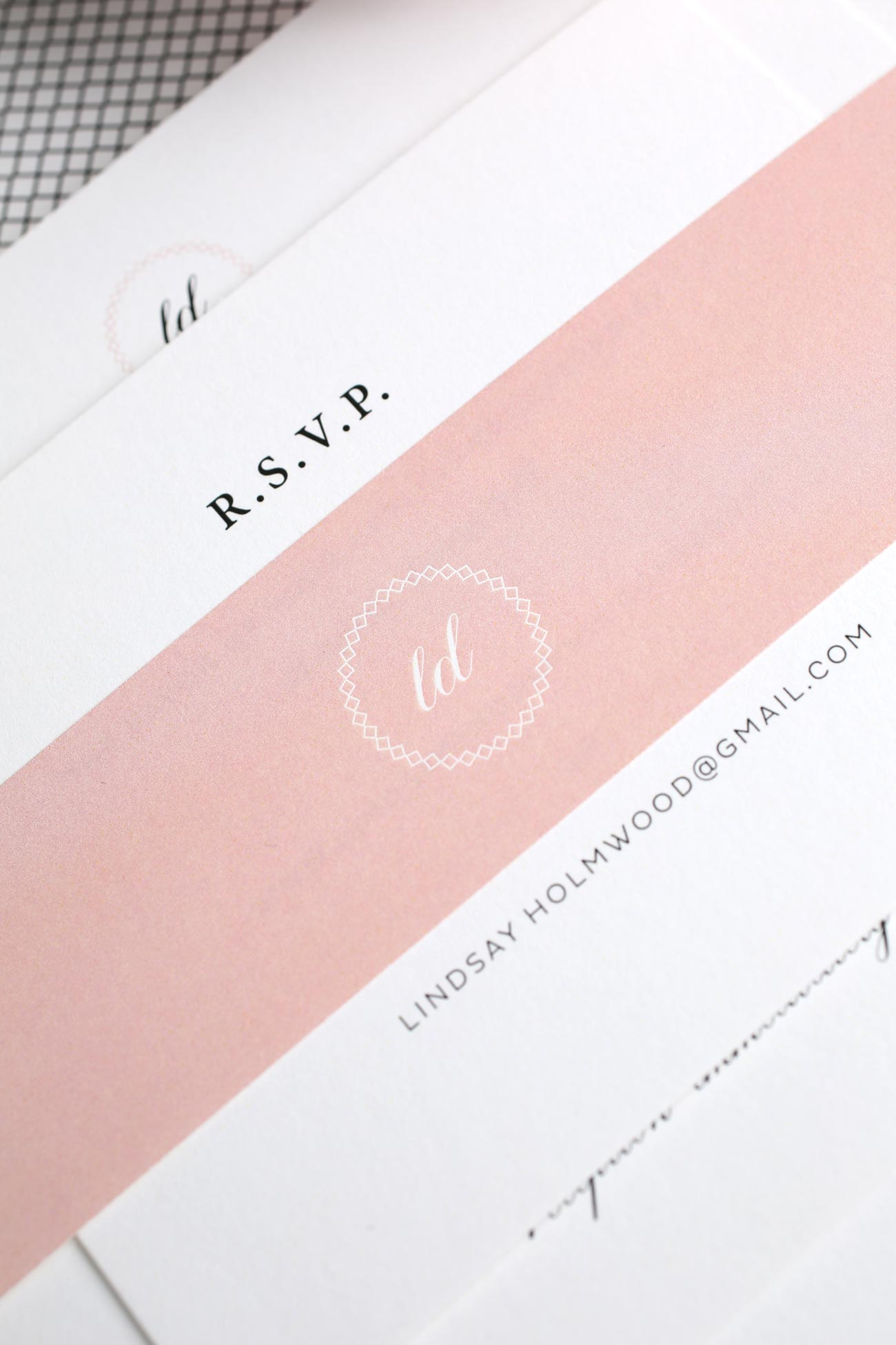 Elegant wedding invitations in blush with a monogram