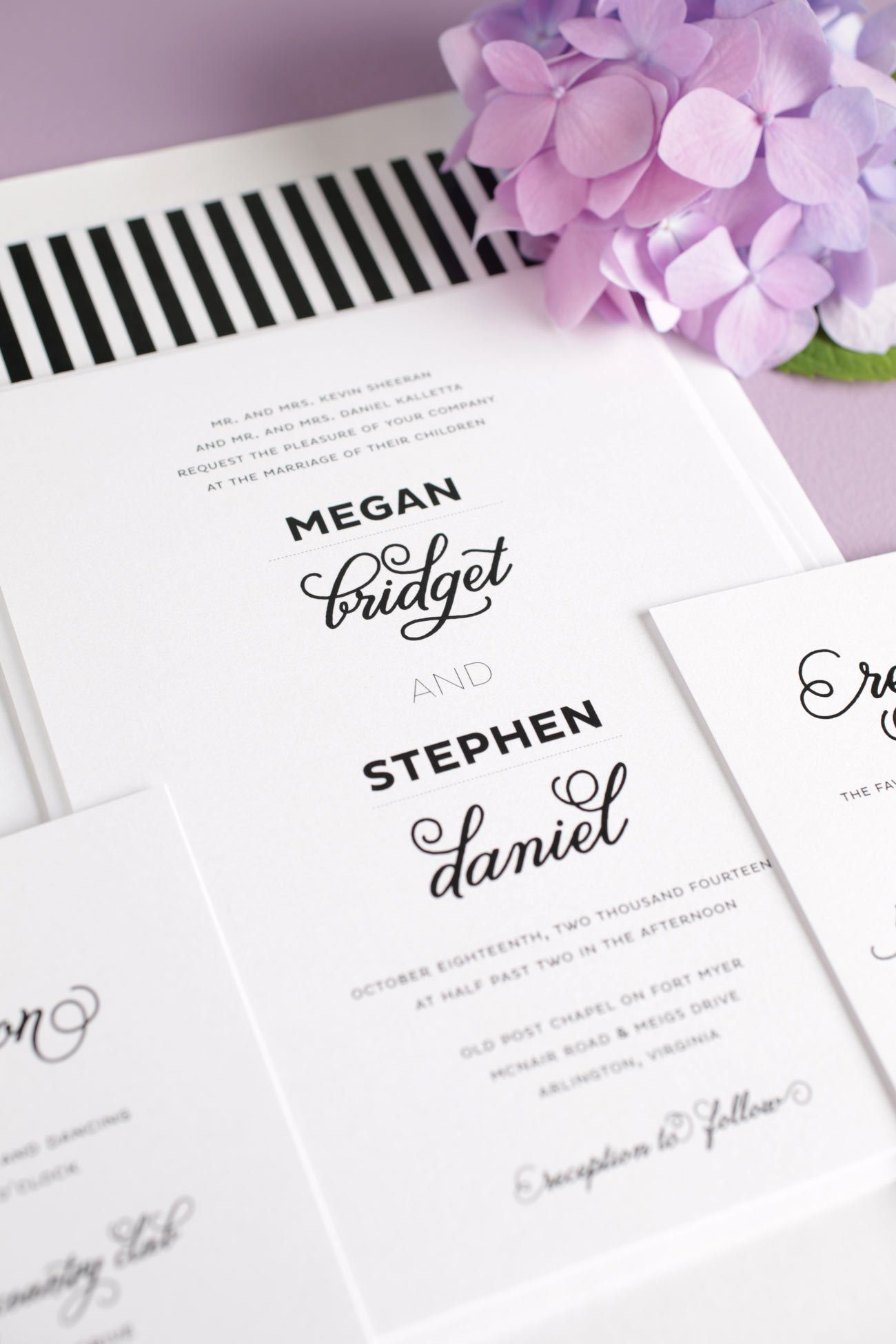 Modern black and white wedding invitations with a striped envelope liner