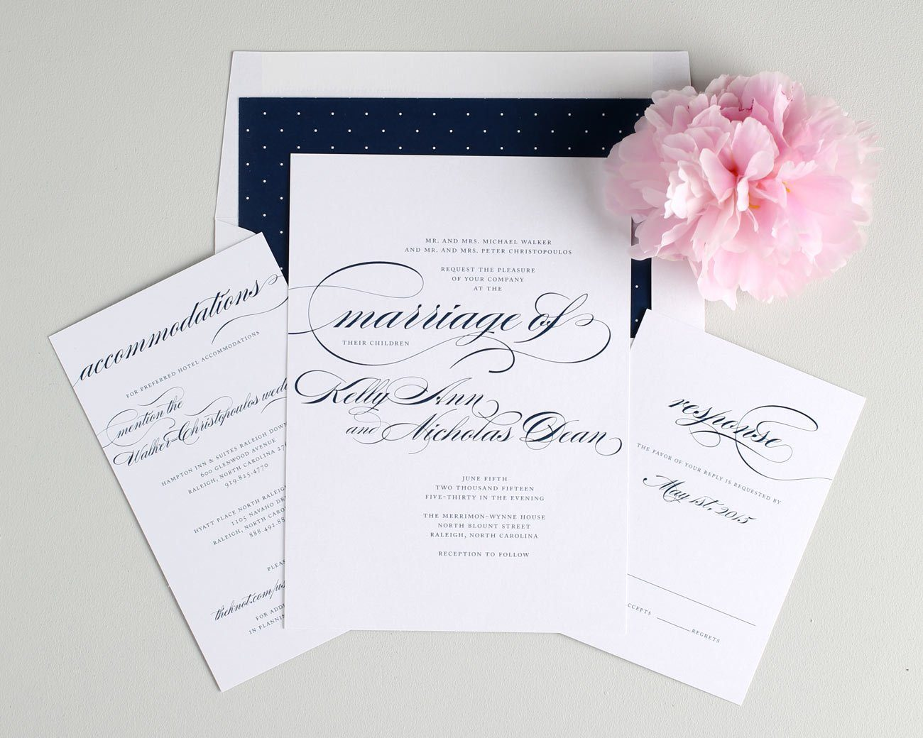 Script wedding invitations with polka dot accents