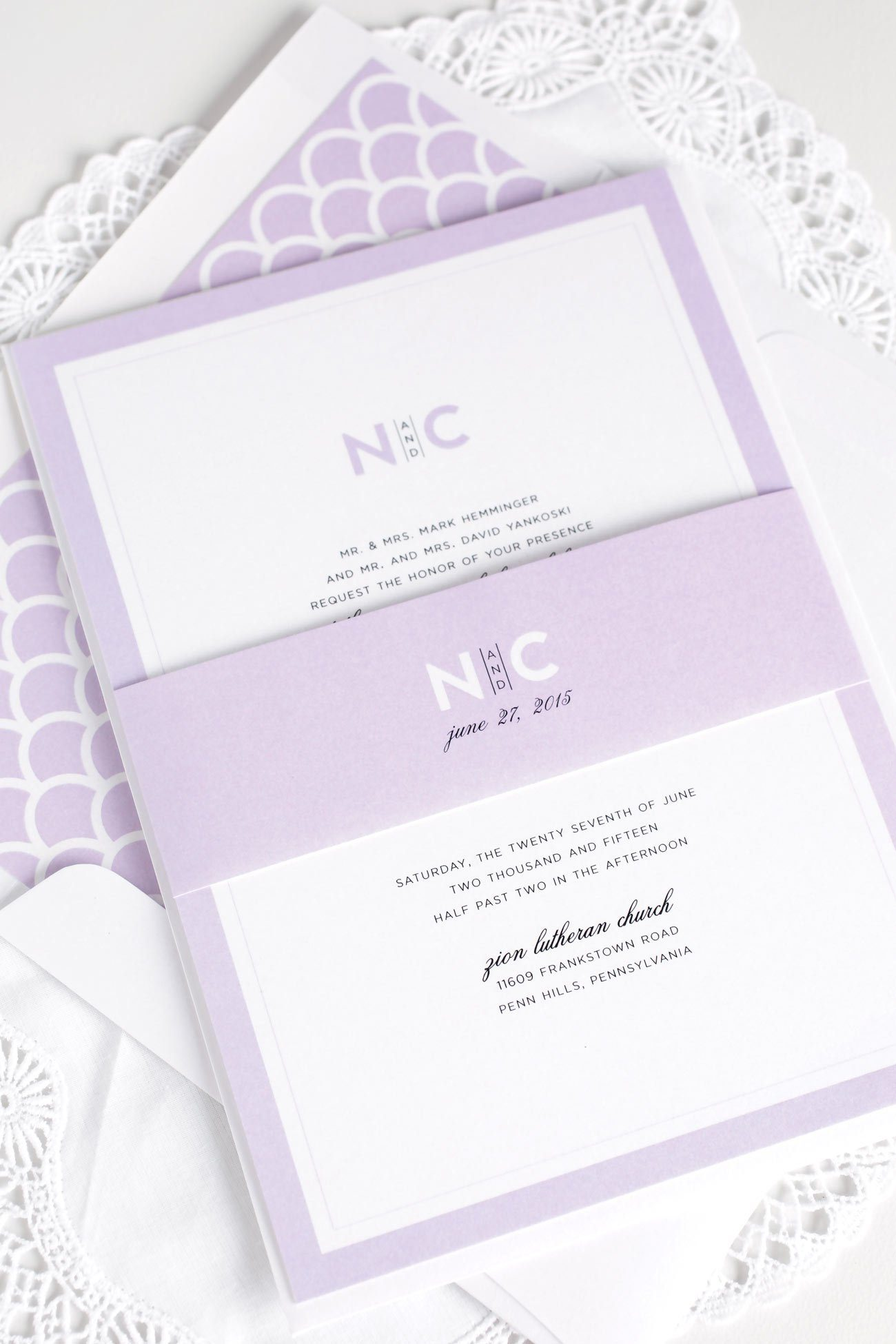Modern wedding invitations in purple with scallop accents