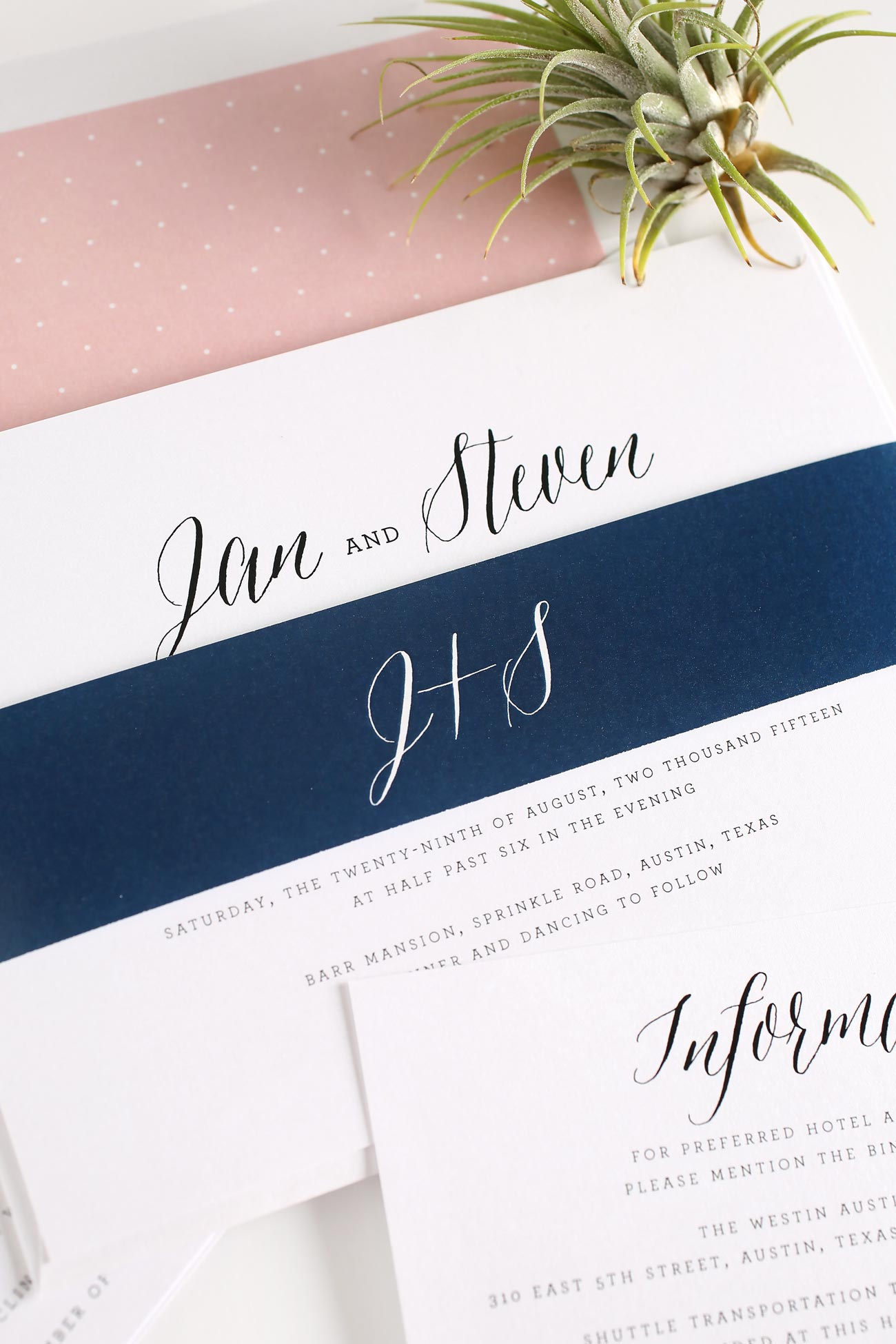 Romantic wedding invitations in navy and blush