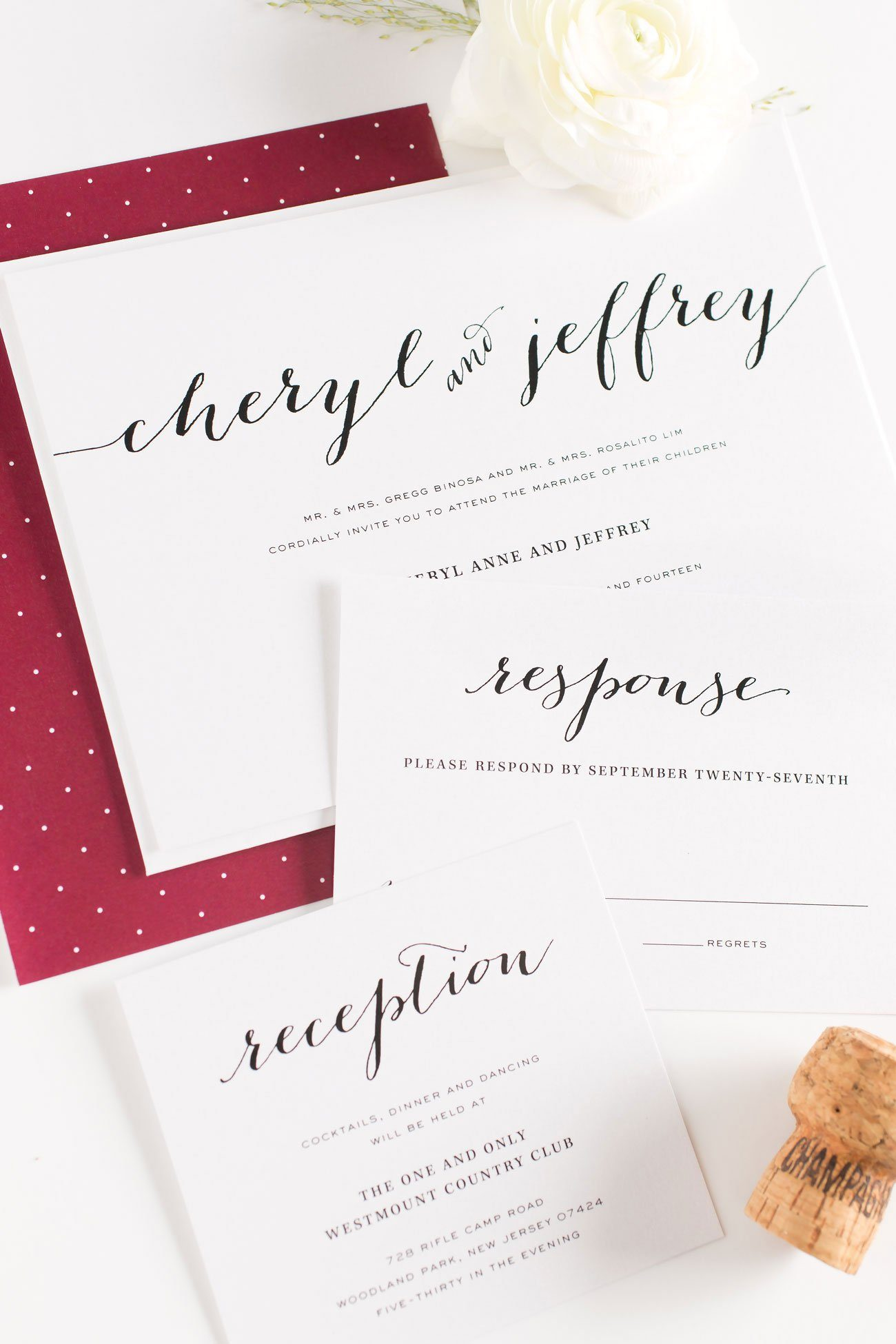 Cranberry wedding invitations with polka dots