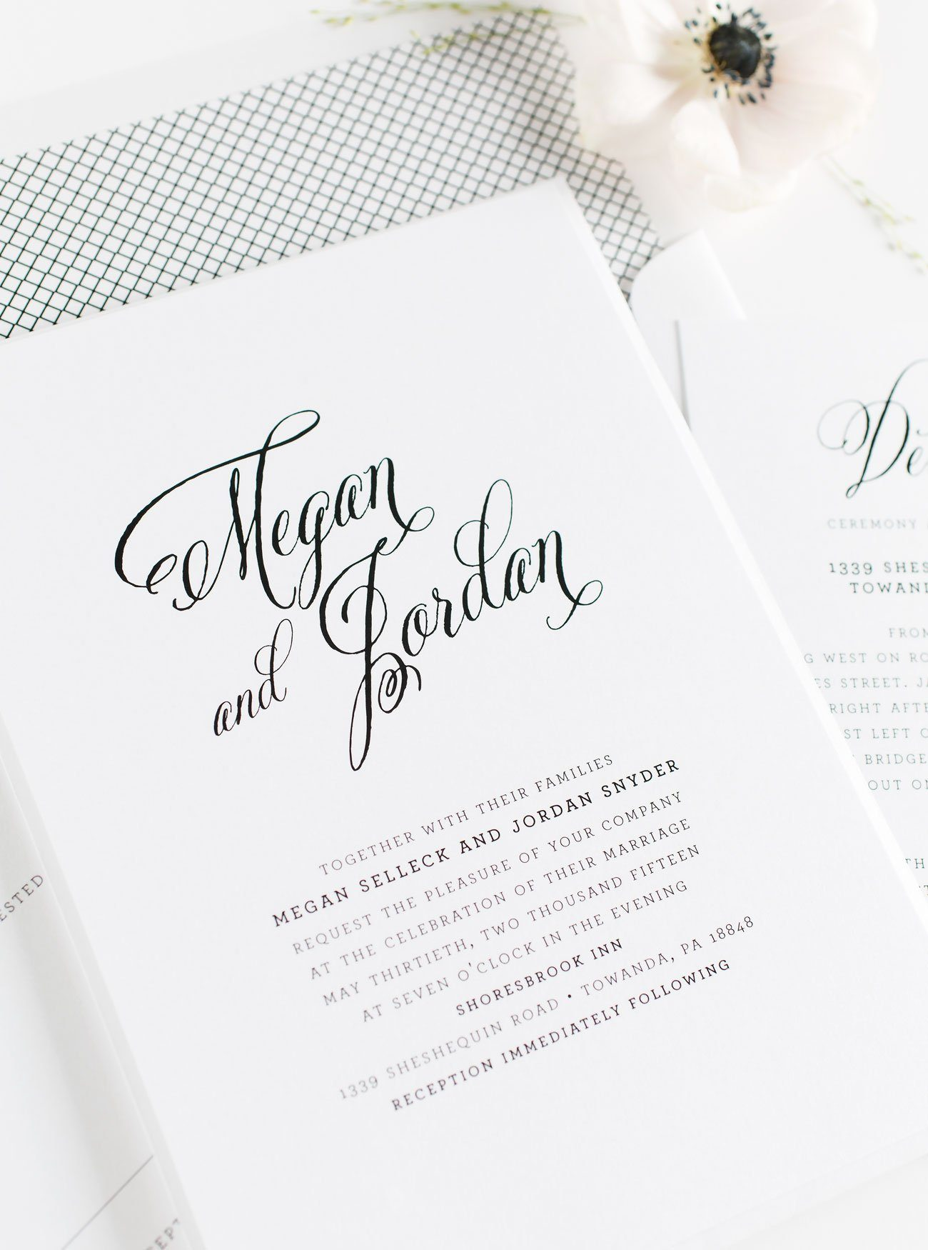 Calligraphy wedding invitations in black and white