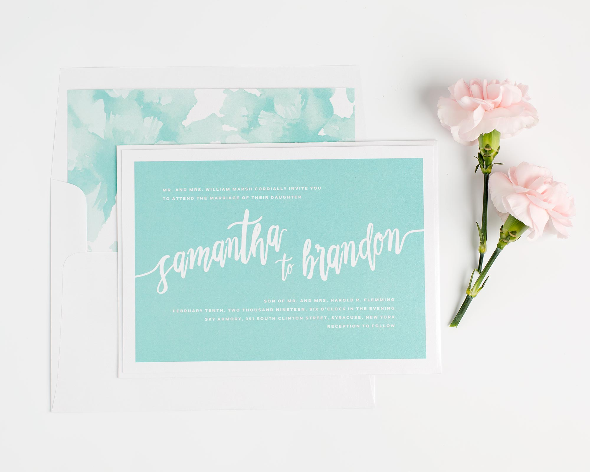 Bold wedding invitations with a watercolor liner