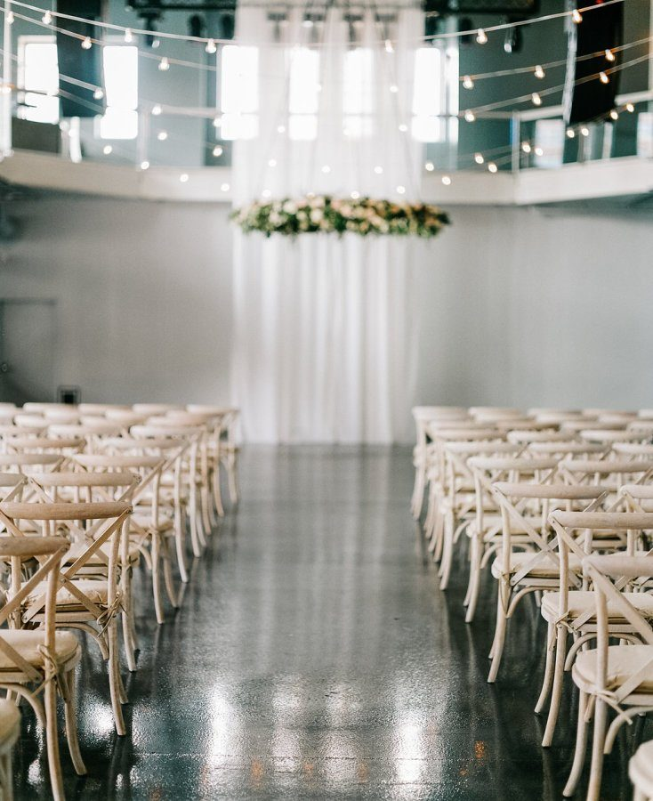 Ceremony Reception with Bistro Lighting and White Curtains