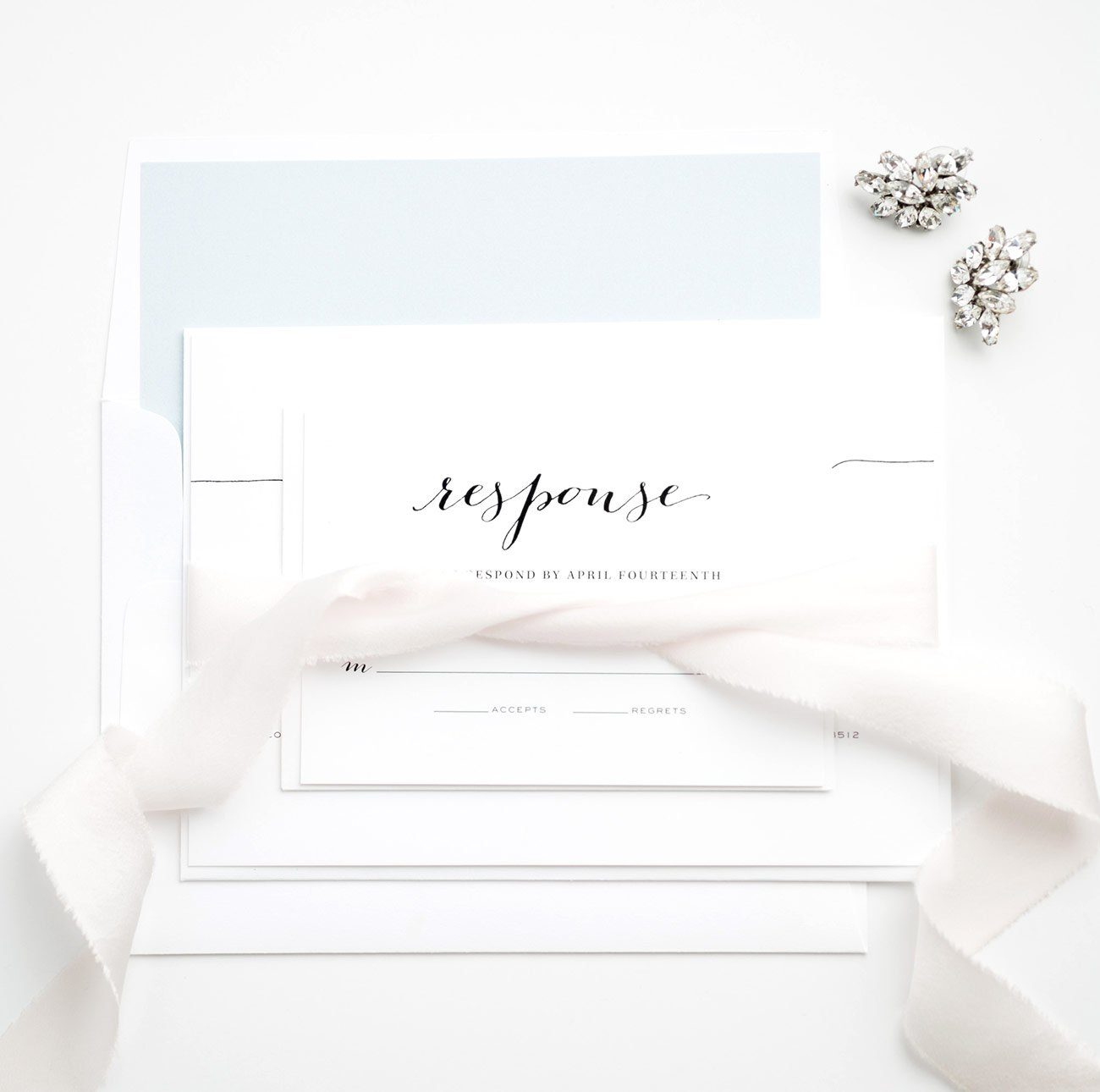 Romantic Wedding Invitations with a silk ribbon in light blue