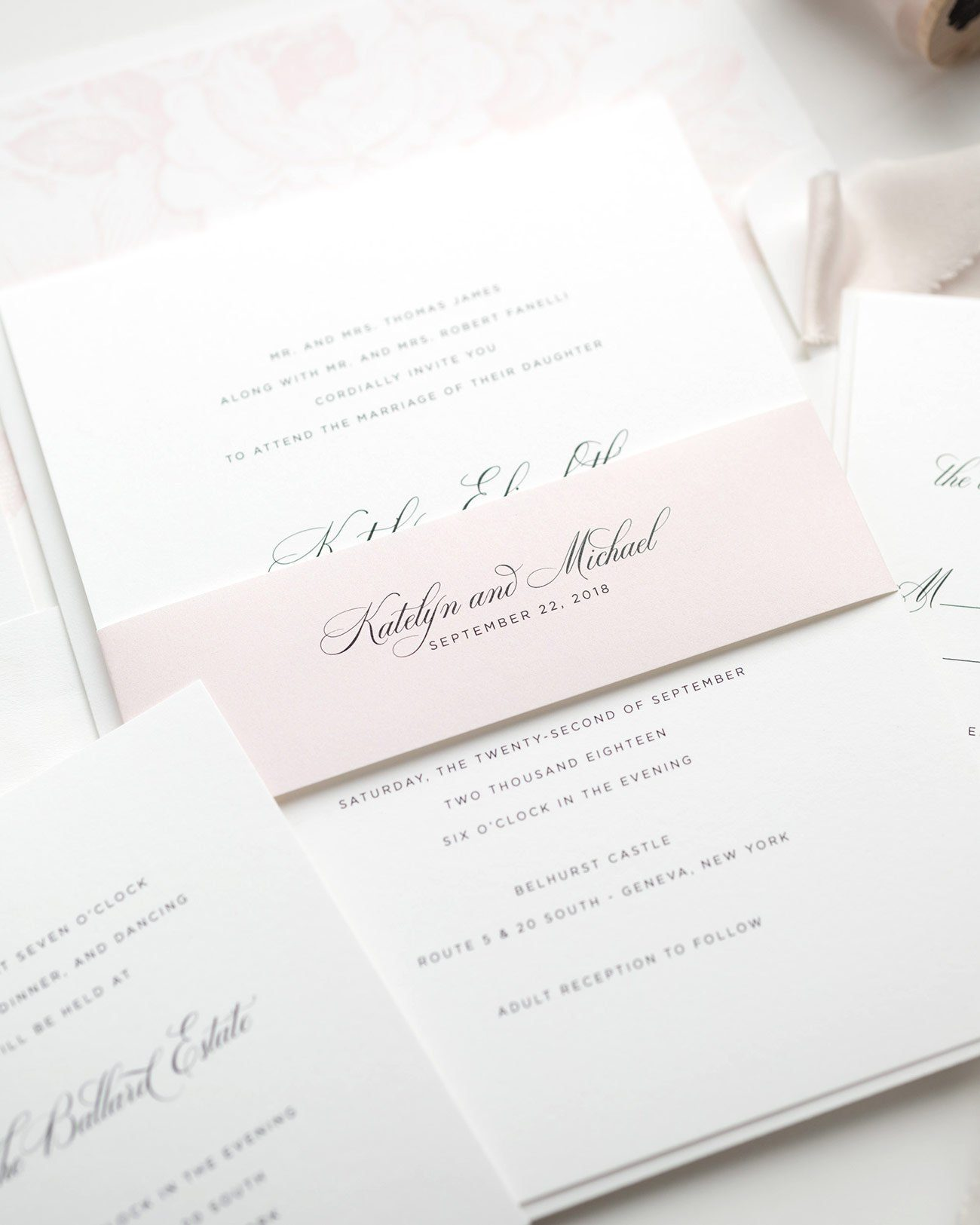Simple Blush Pink Wedding Invitations with Floral Accents