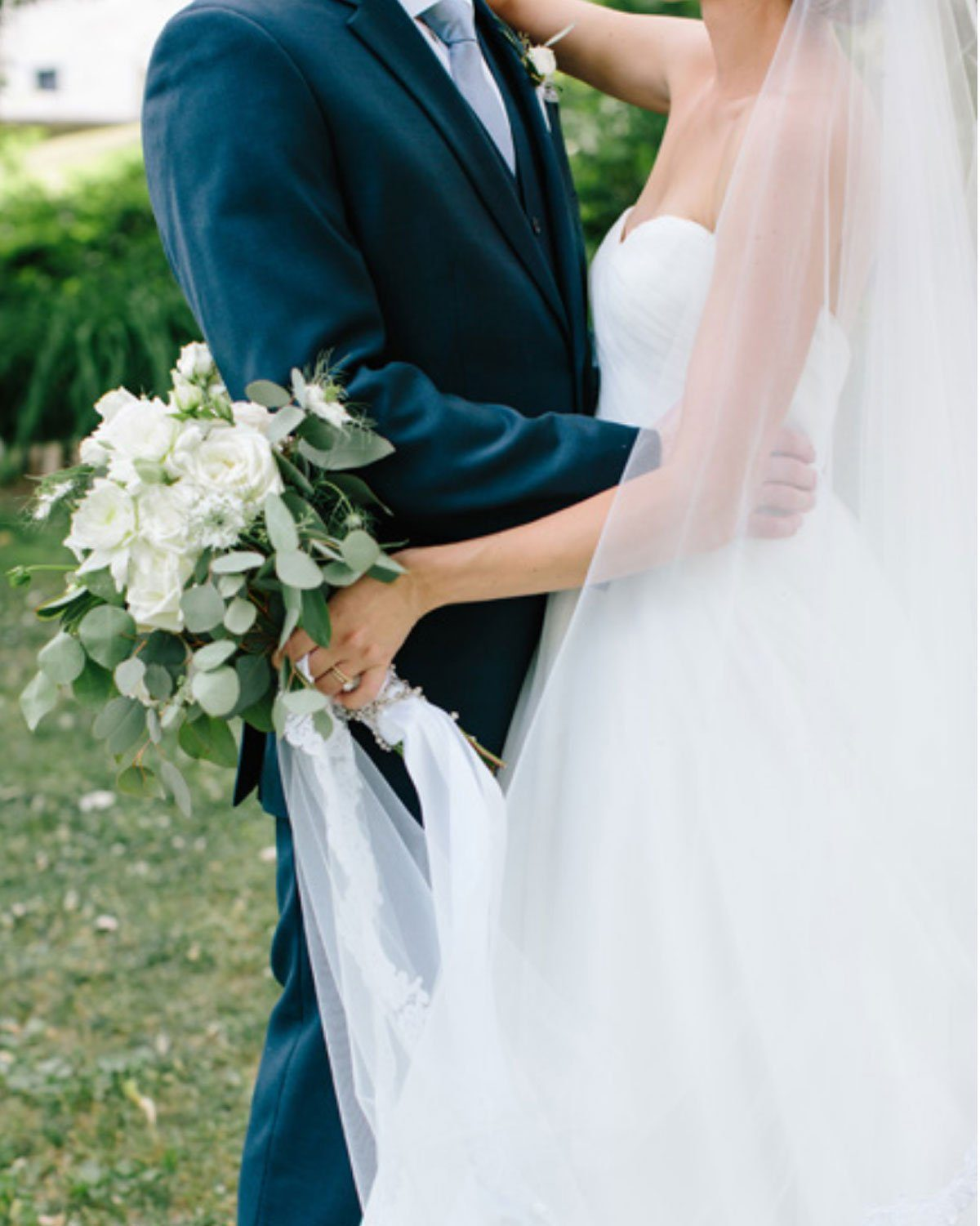 garden wedding bouquet and groom with navy suit