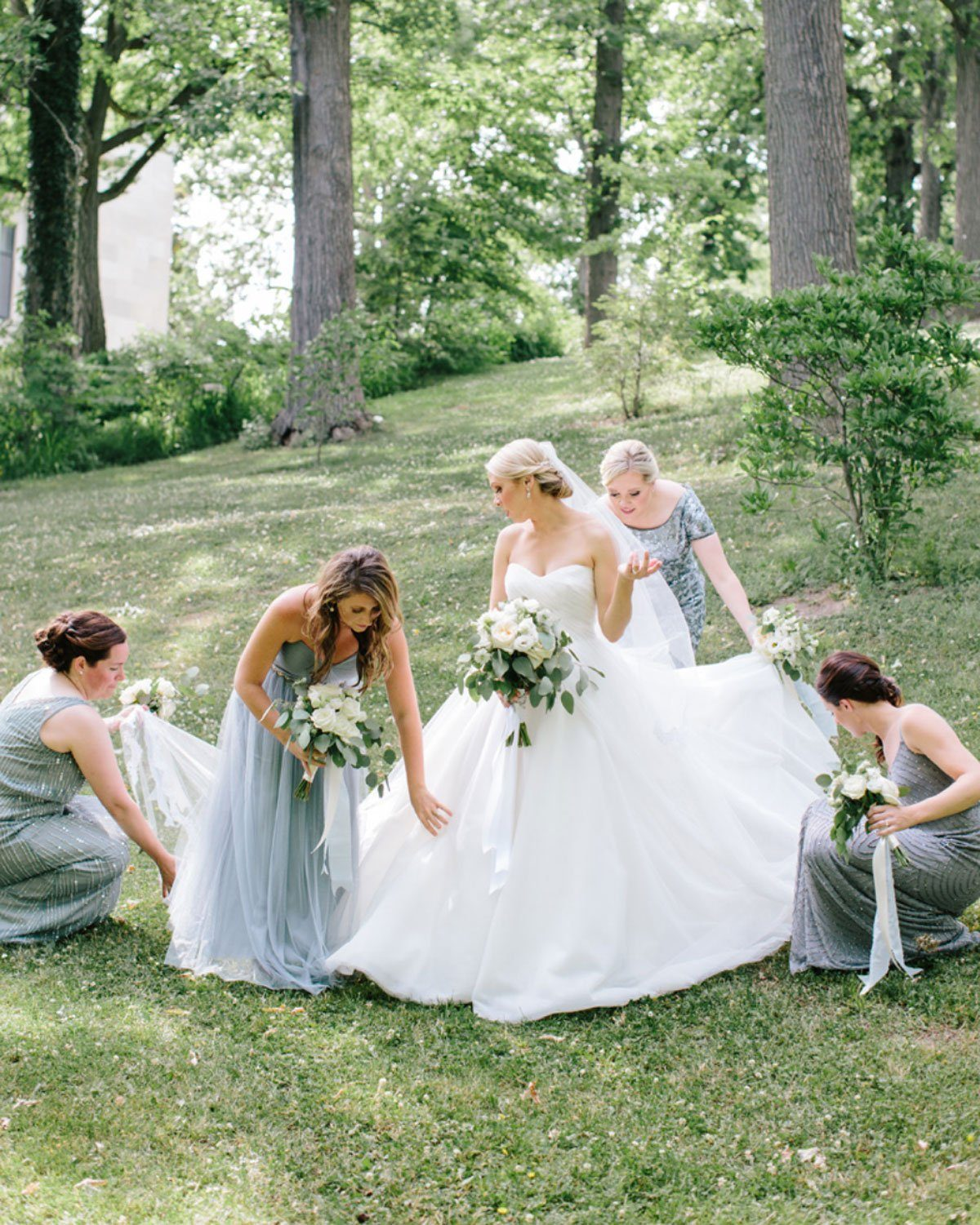 Bridesmaids helping Bride with classic tulle wedding dress