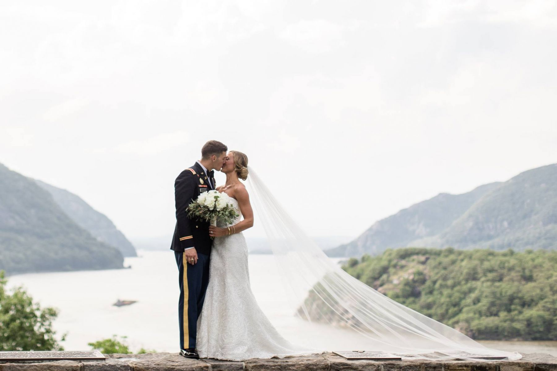 scenic bride and groom kiss